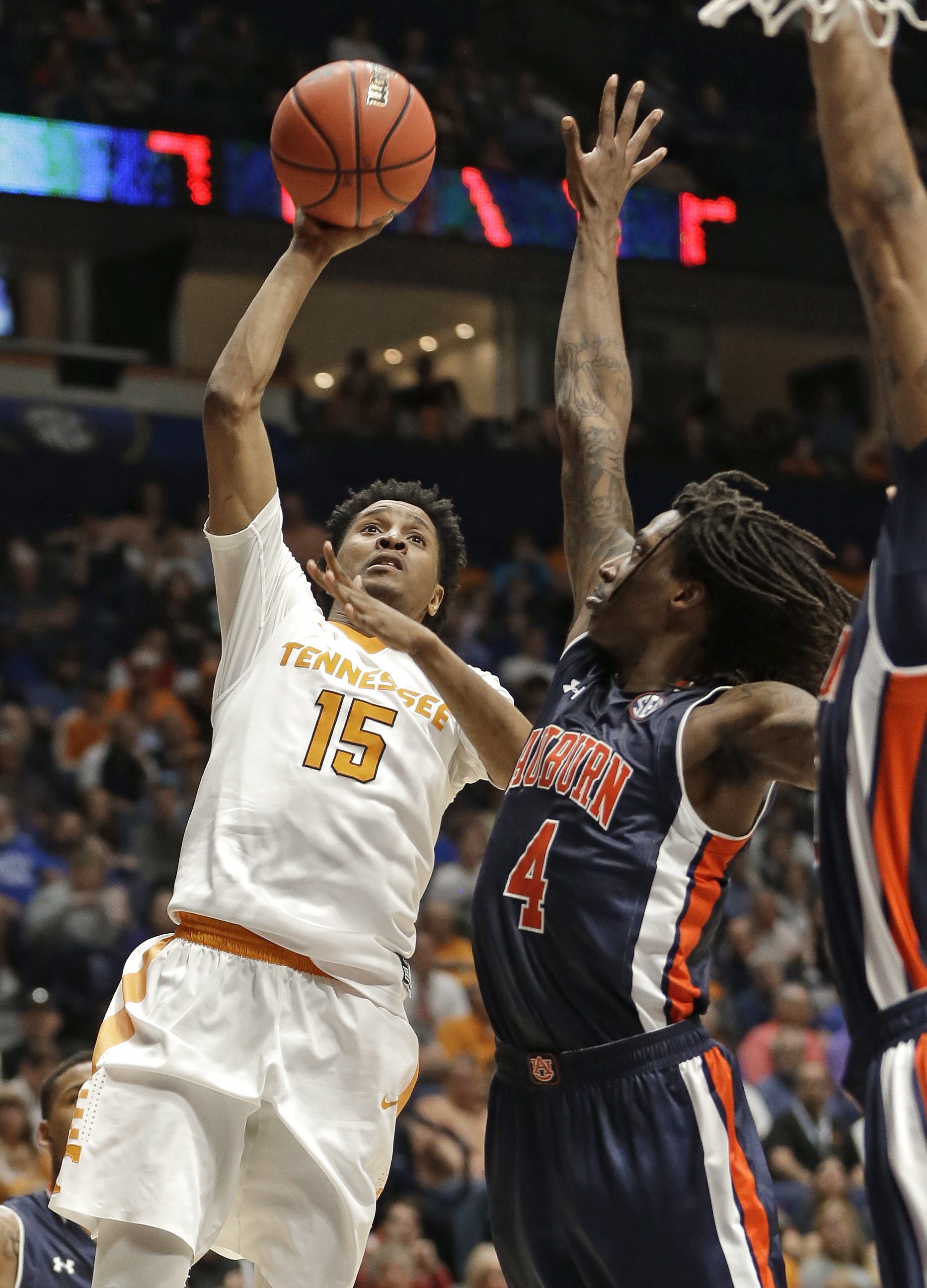 Tennessee's Detrick Mostella (15) shoots over Auburn's T.J. Dunans (4) during the second half of an NCAA college basketball game in the Southeastern Conference tournament in Nashville, Tenn., Wednesday, March 9, 2016. (AP Photo/Mark Humphrey)