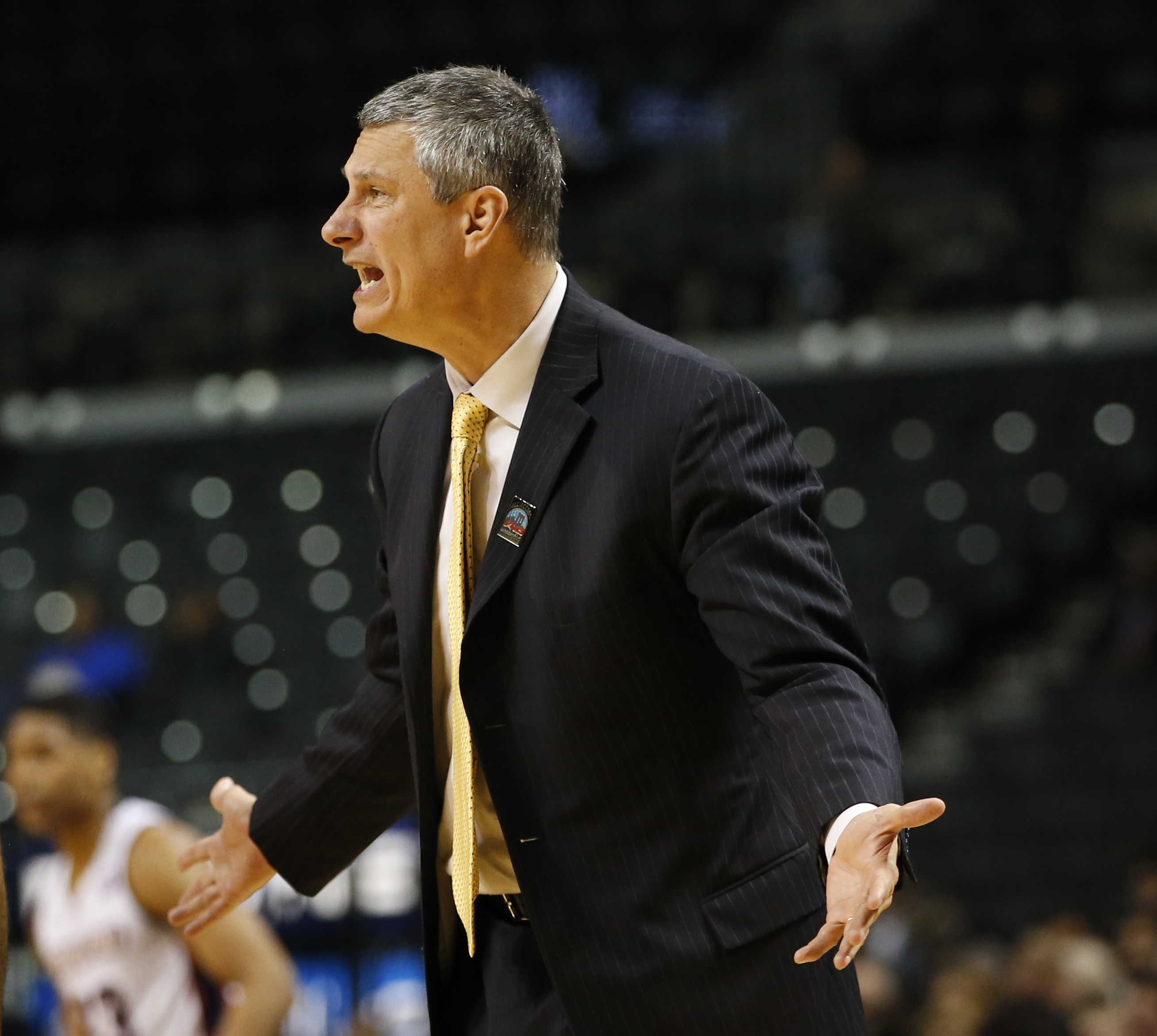 La Salle coach John Giannini gestures toward an official during the first half of the team's NCAA college basketball game against Duquesne in the Atlantic 10 men's tournament, Wednesday, March 9, 2016, in New York. (AP Photo/Kathy Willens)