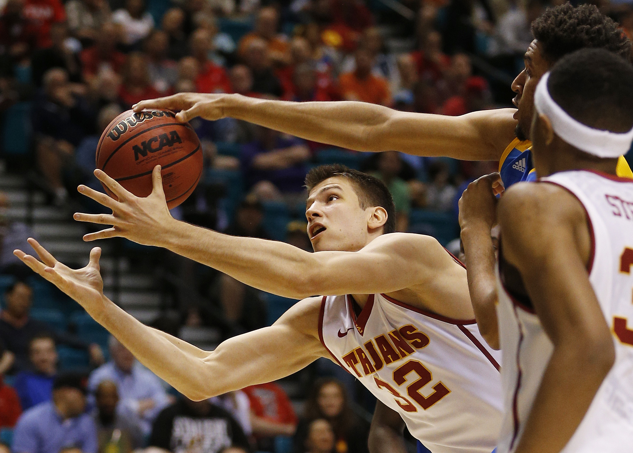 Southern California forward Nikola Jovanovic (32) reaches for the ball during the first half of the team's NCAA college basketball game against UCLA in the first round of the Pac-12 men's tournament Wednesday, March 9, 2016, in Las Vegas. (AP Photo/John L