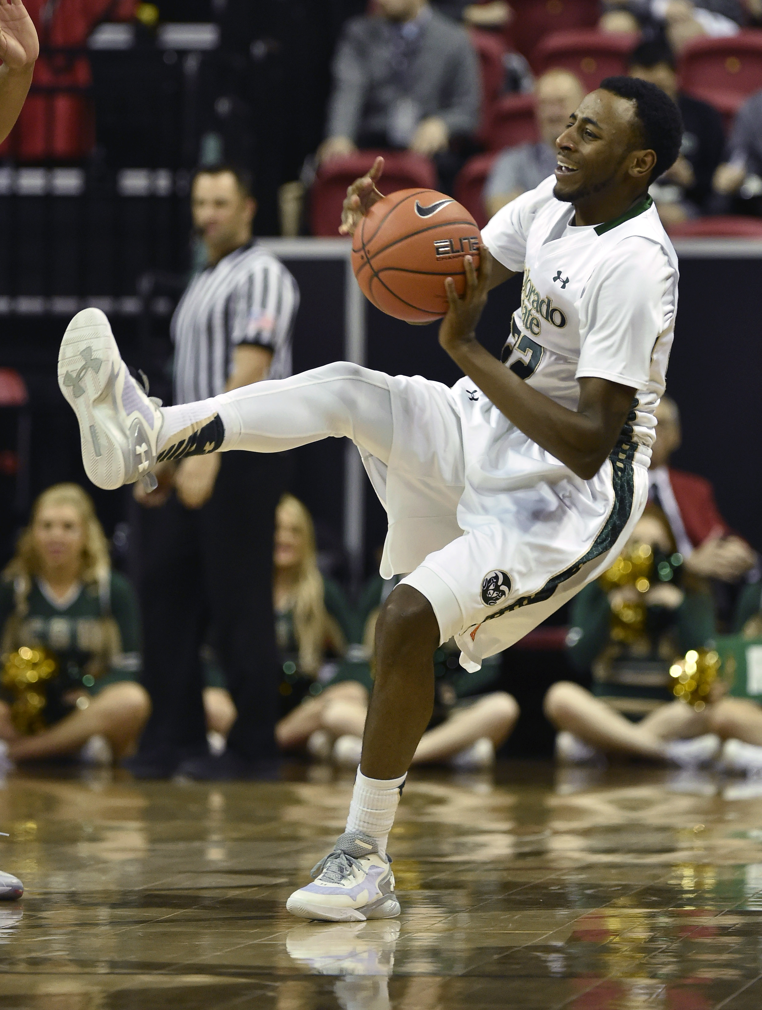 Colorado State's J.D. Paige falls back after being fouled by San Jose State during the second half of an NCAA college basketball game at the Mountain West Conference men's tournament Wednesday, March 9, 2016, in Las Vegas. Colorado State won 80-61. (AP Ph