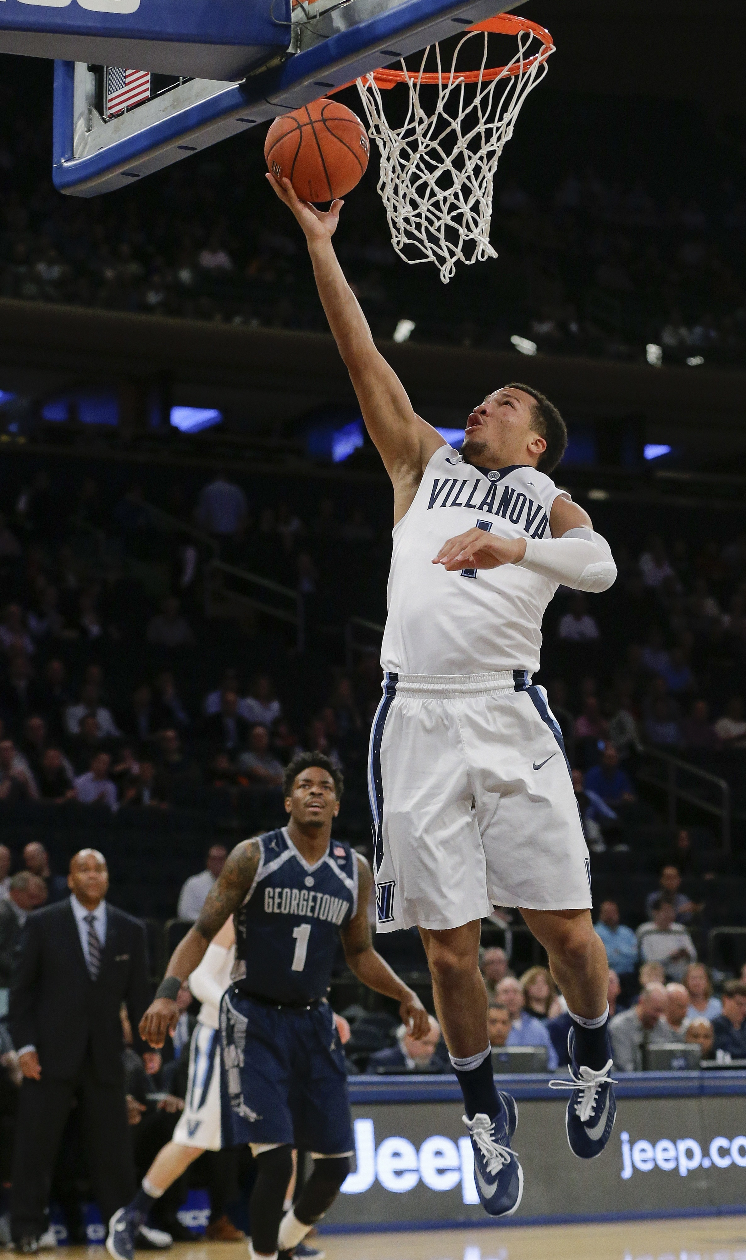 Villanova's Jalen Brunson (1) drives past Georgetown's Tre Campbell (1) during the first half of an NCAA college basketball game during the Big East men's tournament Thursday, March 10, 2016, in New York. (AP Photo/Frank Franklin II)