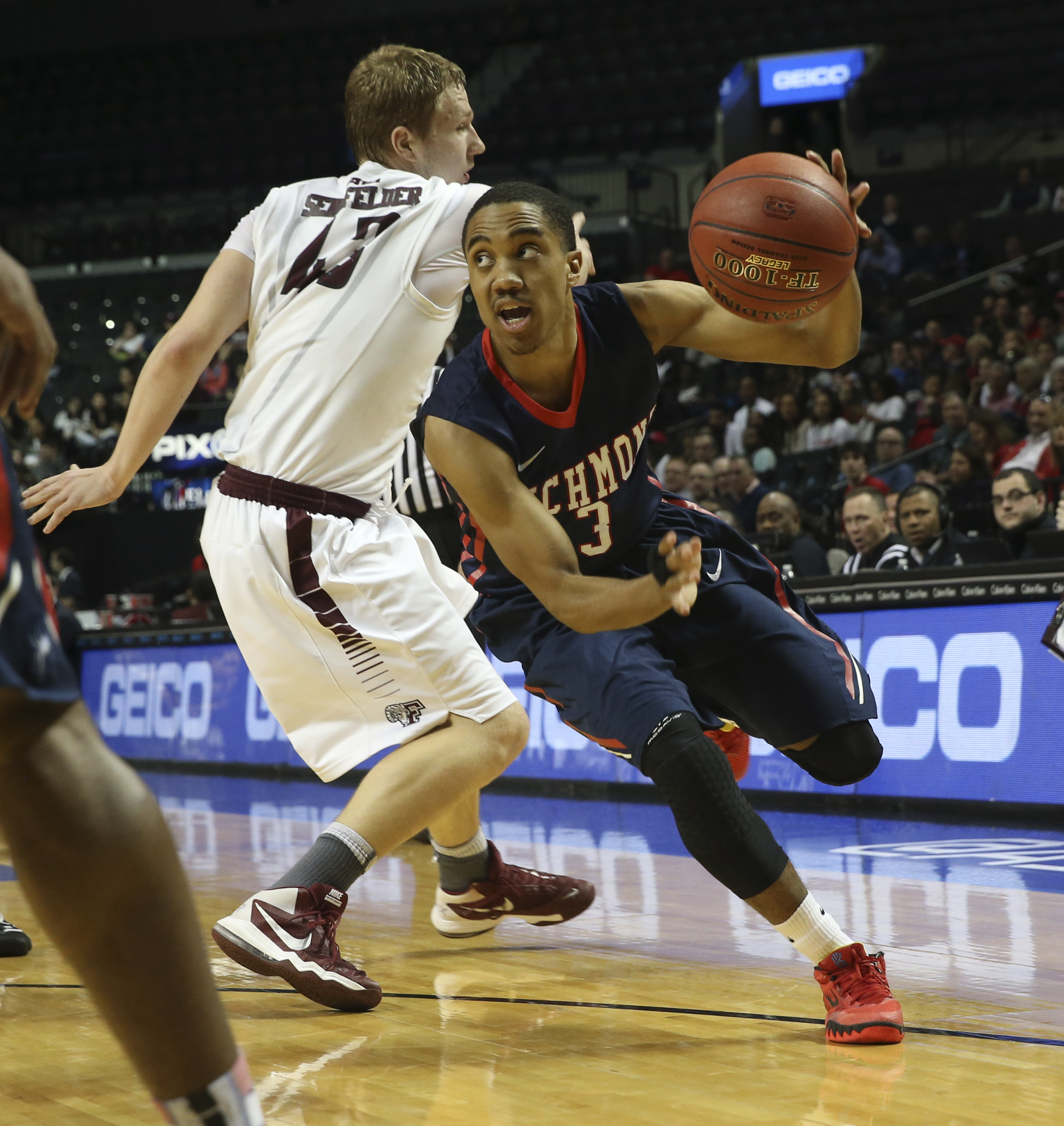 Richmond guard ShawnDre' Jones (3) drives to the basket past Fordham forward Christian Sengfelder (43) during the first half of an NCAA college basketball game in the Atlantic 10 men's tournament, Thursday, March 10, 2016, at New York. (AP Photo/Mary Alta