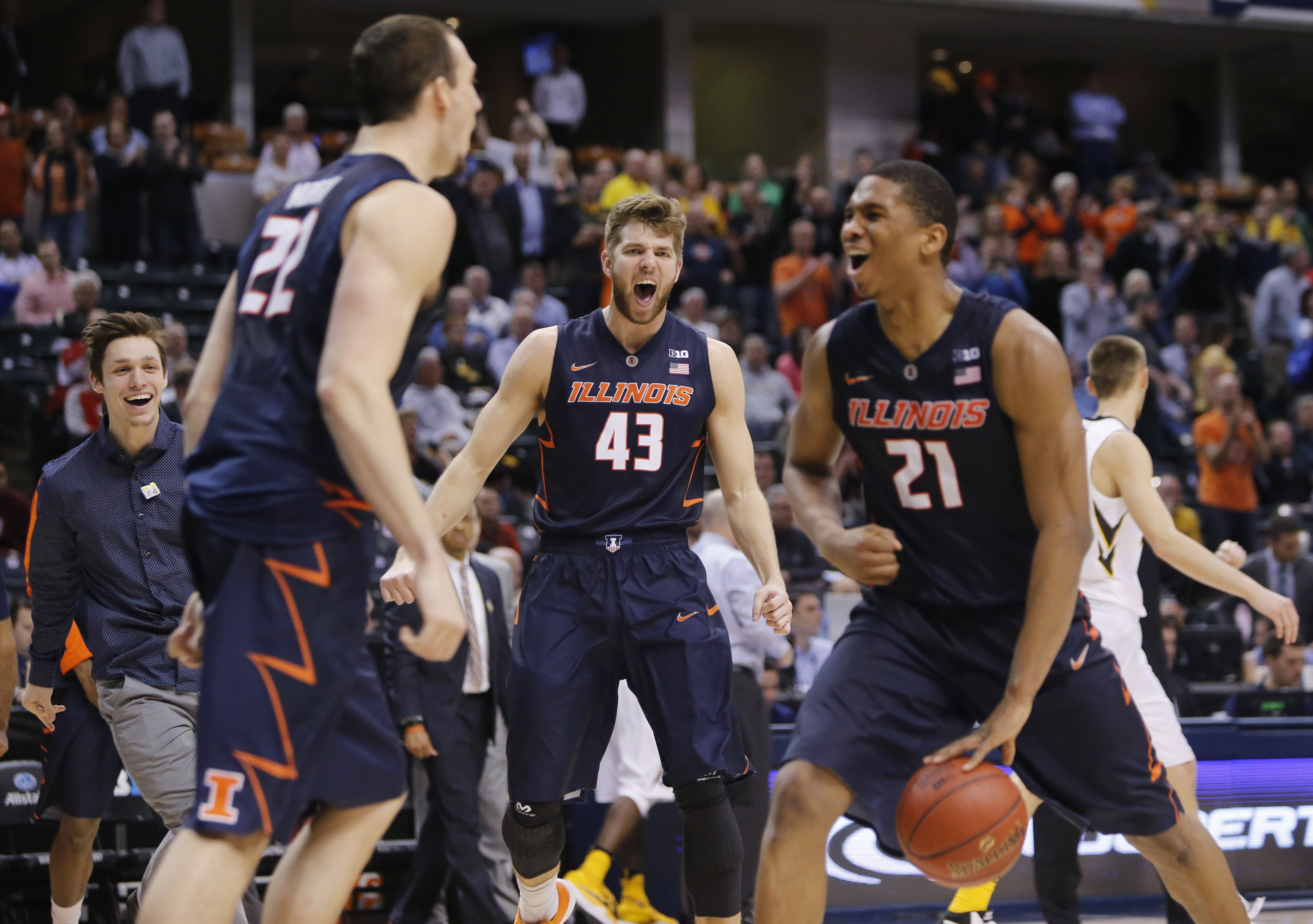 Illinois' Maverick Morgan (22), Michael Finke (43) and Malcolm Hill (21) celebrate after an NCAA college basketball game against Iowa at the Big Ten Conference tournament, Thursday, March 10, 2016, in Indianapolis. Illinois won 68-66. (AP Photo/Kiichiro S