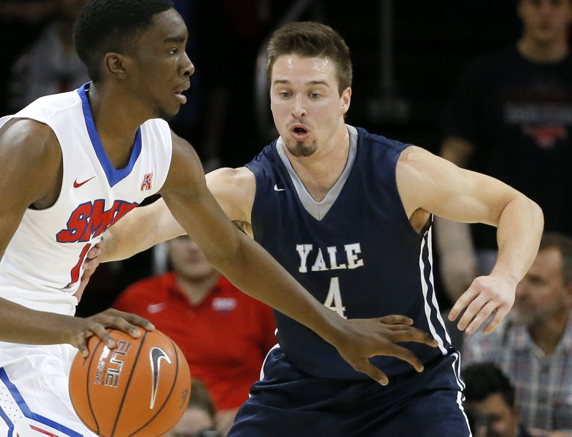 In this Nov. 22, 2015, photo, Yale's Jack Montague, right, defends against SMU guard Shake Milton during an NCAA college basketball game in Dallas. Yale announced on Feb. 24, 2016, that Montague was no longer on the team. Citing federal privacy law, Yale