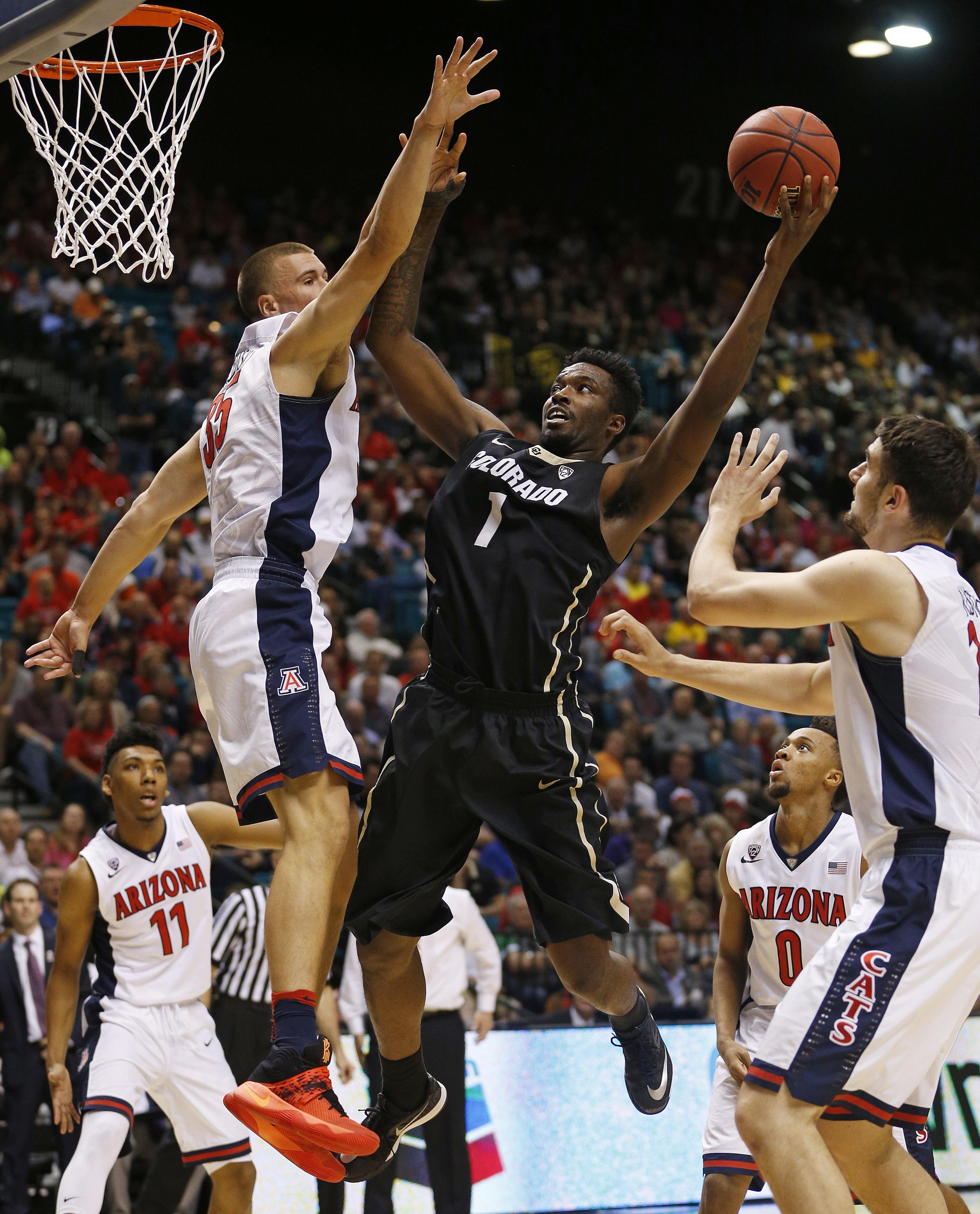 Colorado forward Wesley Gordon (1) shoots around Arizona center Kaleb Tarczewski, left, during the first half of an NCAA college basketball game in the quarterfinal round of the Pac-12 men's tournament Thursday, March 10, 2016, in Las Vegas. (AP Photo/Joh