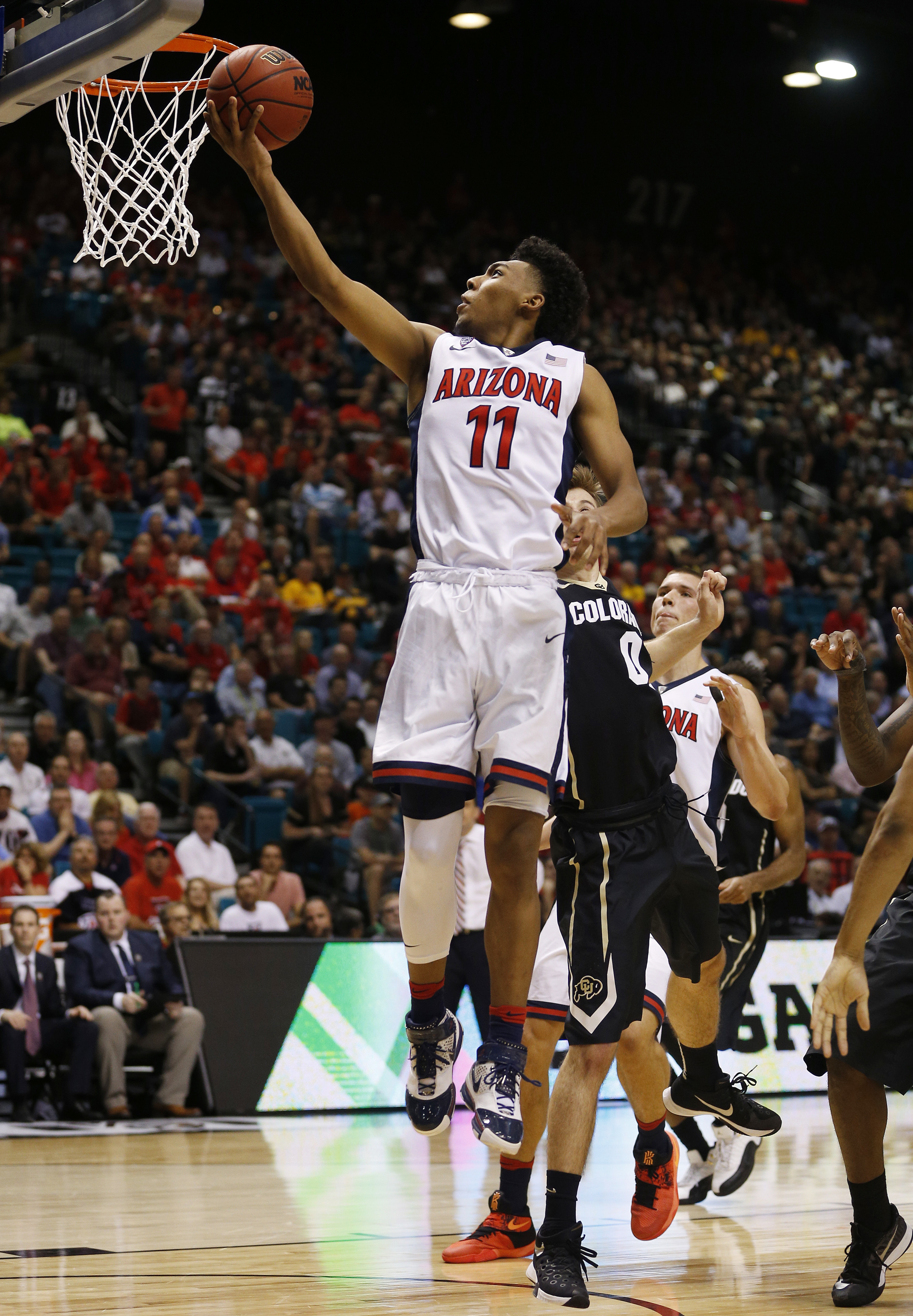 Arizona guard Allonzo Trier shoots against Colorado during the second half of an NCAA college basketball game in the quarterfinal round of the Pac-12 men's tournament Thursday, March 10, 2016, in Las Vegas. Arizona won 82-78. (AP Photo/John Locher)
