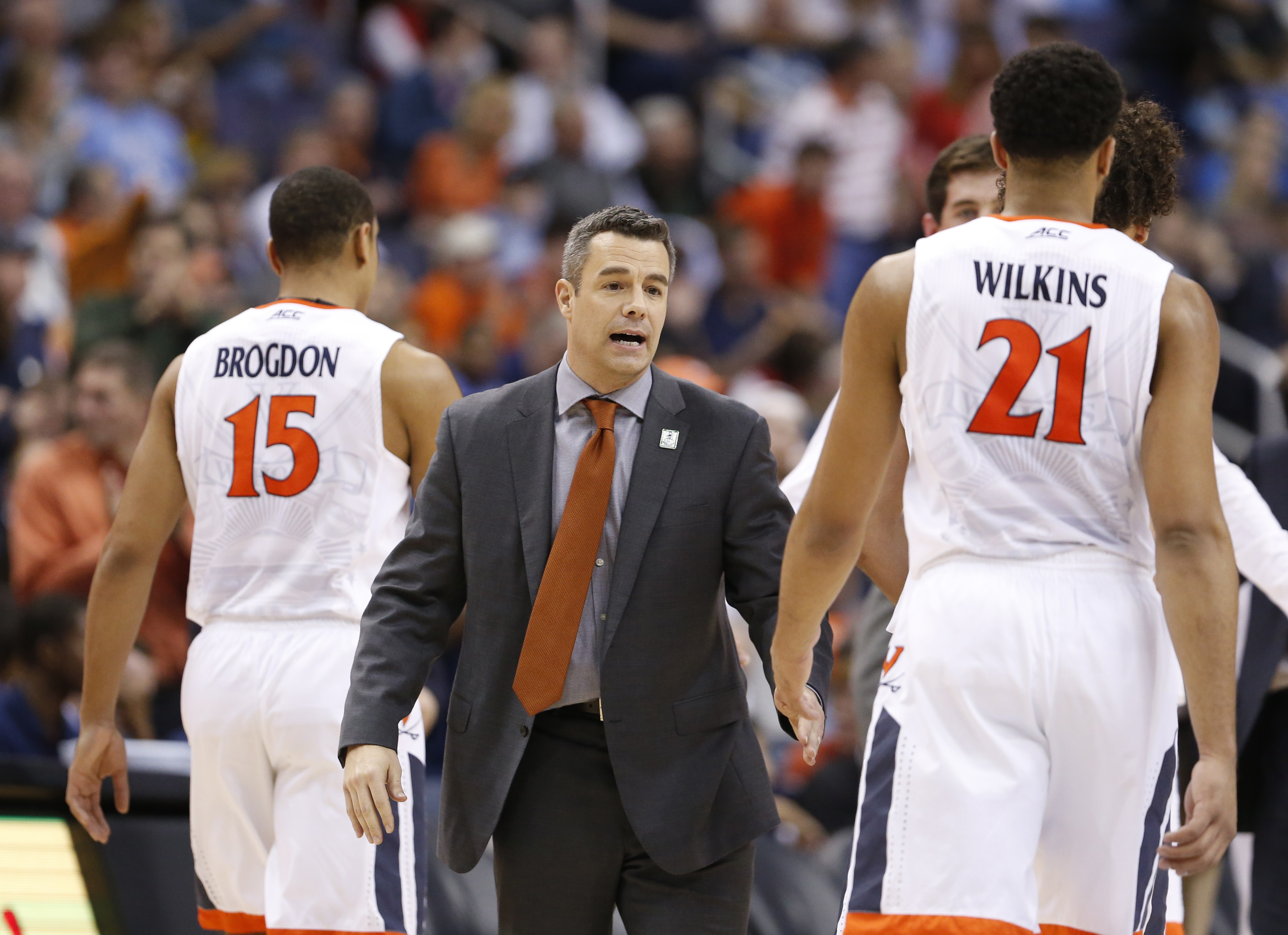 Virginia coach Tony Bennett welcomes guard Malcolm Brogdon (15) and forward Isaiah Wilkins (21) back to the bench during the second half of an NCAA college basketball game against Georgia Tech in the Atlantic Coast Conference men's tournament in Washingto