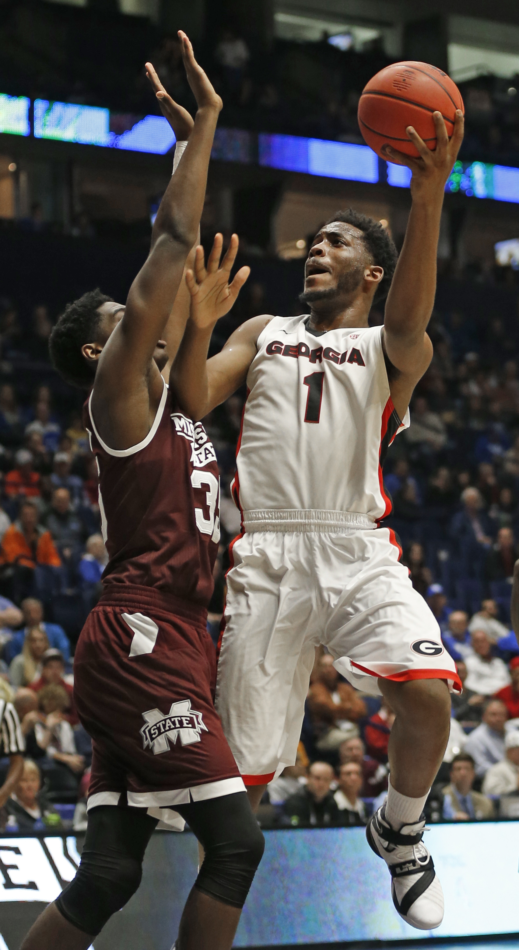 Georgia's Yante Maten (1) shoots over Mississippi State's Aric Holman (35) during the first half of an NCAA college basketball game in the Southeastern Conference tournament in Nashville, Tenn., Thursday, March 10, 2016. (AP Photo/John Bazemore)