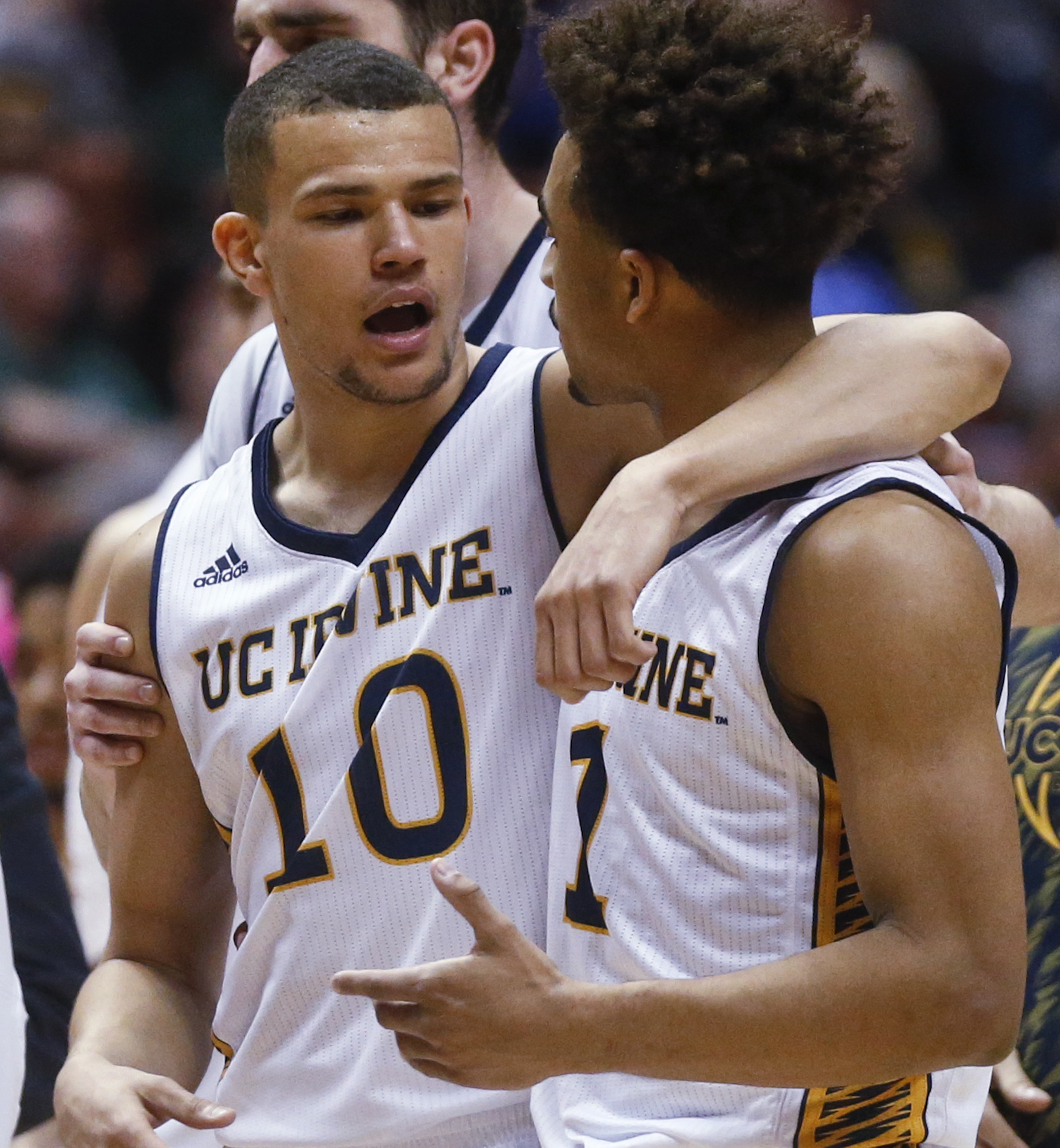 UC Irvine guard Luke Nelson (10) puts his arm around teammate Alex Young during a timeout in the second half of an NCAA college basketball game against Cal Poly at the Big West conference men's tournament Thursday, March 10, 2016, in Anaheim, Calif. Nelso