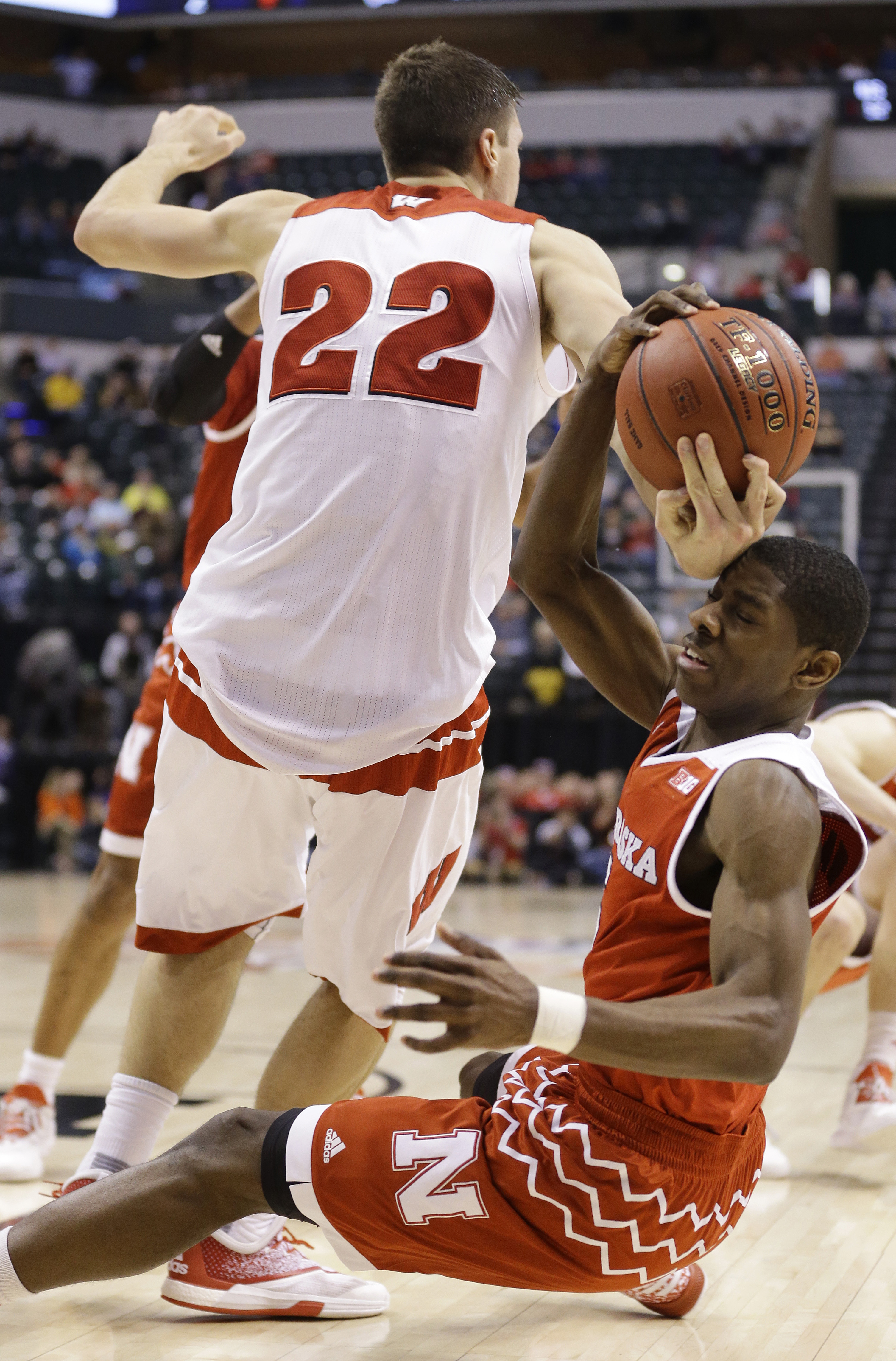 Wisconsin's Ethan Happ (22) and Nebraska's Glynn Watson Jr. (5) battle for the possession of the ball in the second half of an NCAA college basketball game at the Big Ten Conference tournament, Thursday, March 10, 2016, in Indianapolis. Nebraska won 70-58
