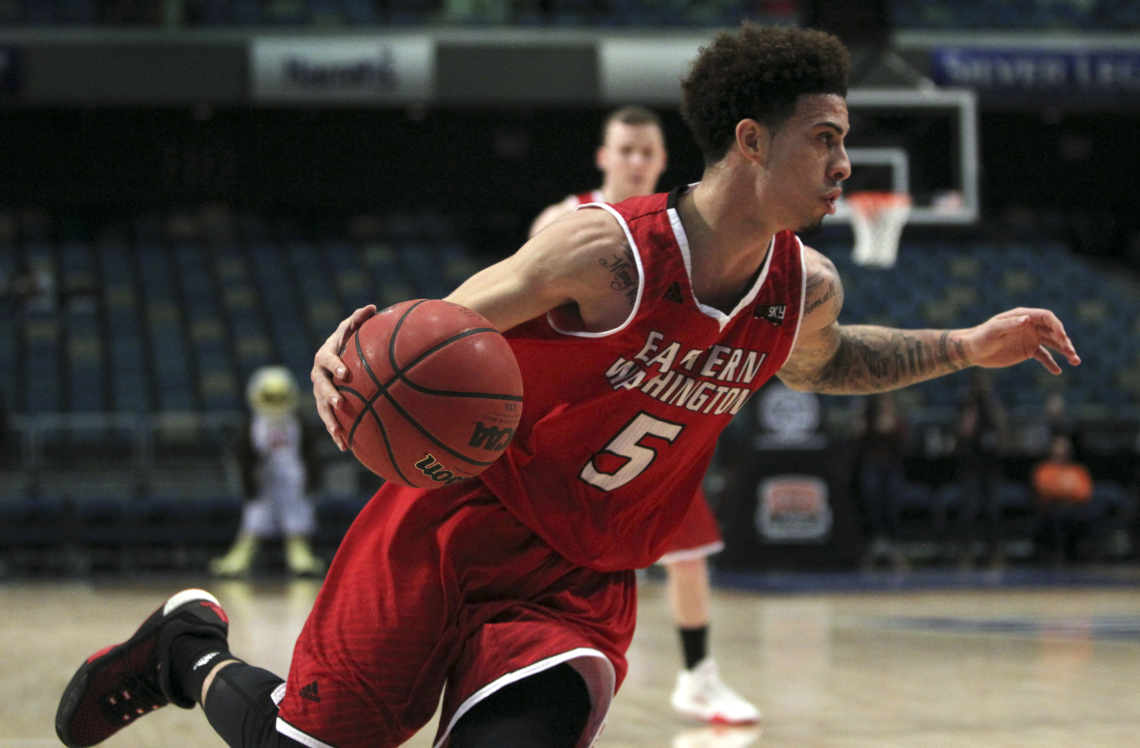 Eastern Washington guard Austin McBroon (5) drives to the basket during the first half of an NCAA college basketball game against Idaho in the Big Sky Conference men's tournament in Reno, Nev., Thursday, March 10, 2016. (AP Photo/Lance Iversen)