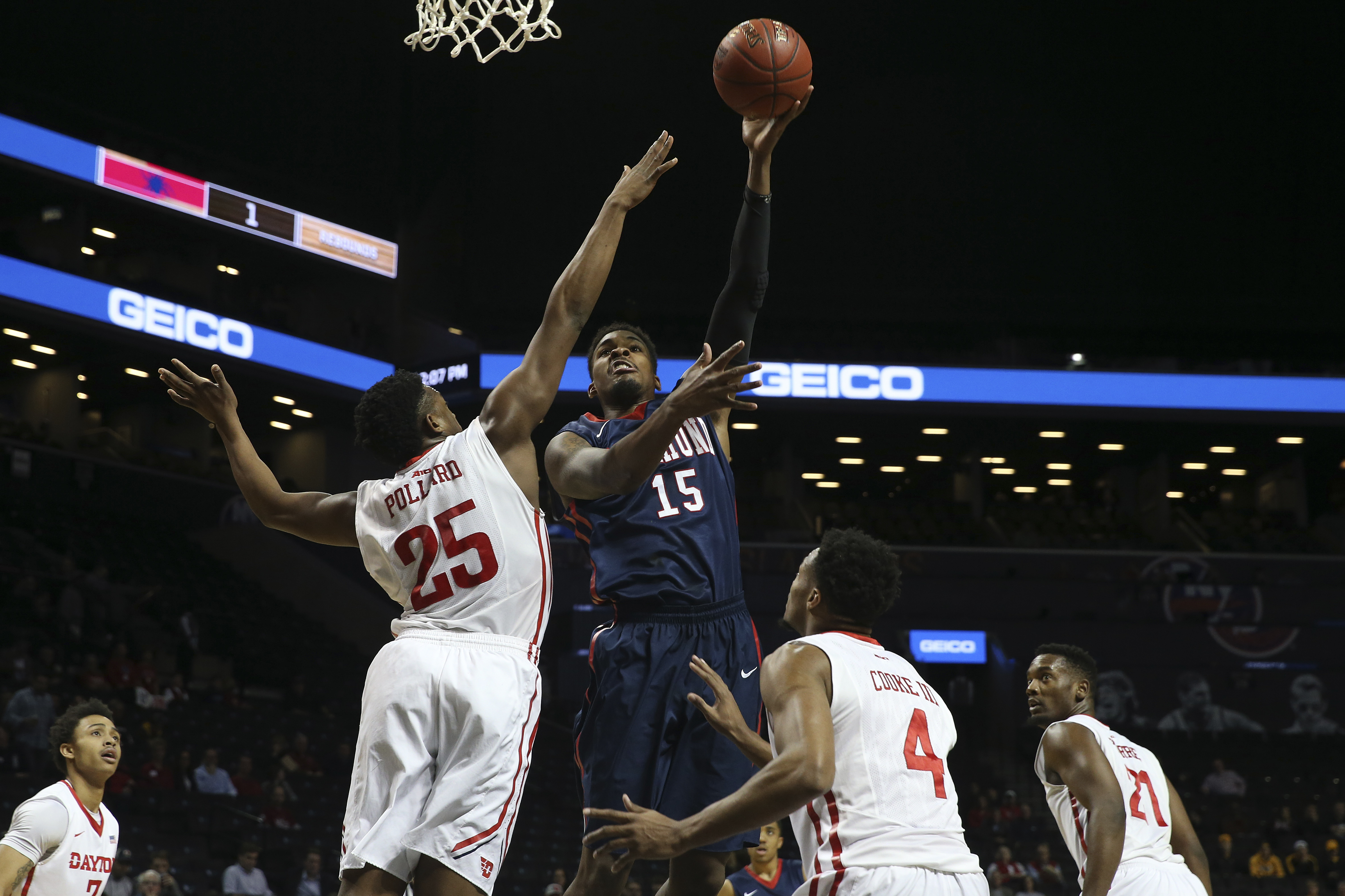 Richmond forward Terry Allen (15) goes to the basket against Dayton forward Kendall Pollard (25) during the first half of an NCAA college basketball game in the Atlantic 10 men's tournament, Friday, March 11, 2016, at New York. (AP Photo/Mary Altaffer)