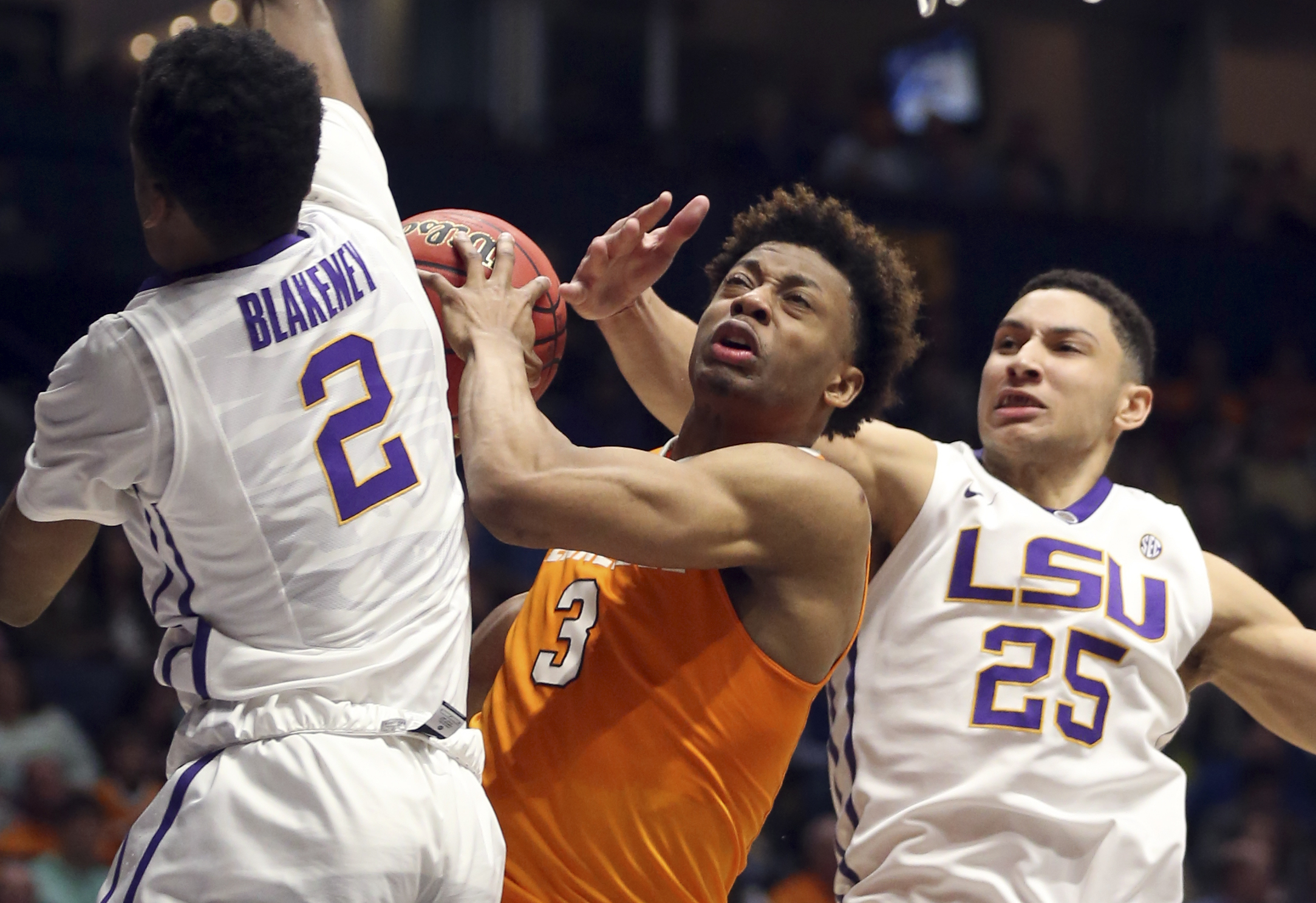 Tennessee's Robert Hubbs III (3) tries to drive against LSU's Ben Simmons (25) and Antonio Blakeney (2) during the second half of an NCAA college basketball game in the Southeastern Conference tournament in Nashville, Tenn., Friday, March 11, 2016. (AP Ph