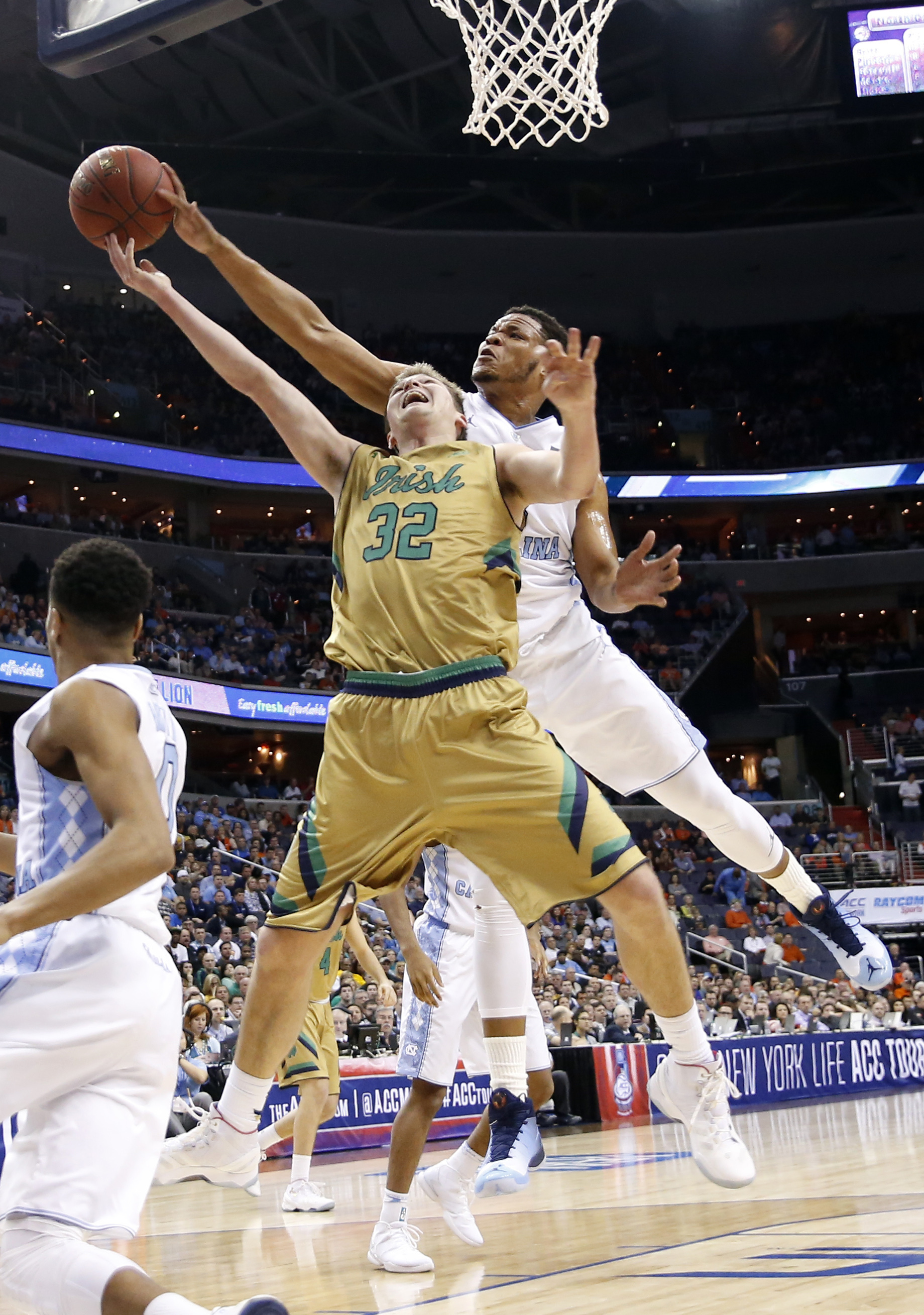 Notre Dame guard Steve Vasturia (32) has his shot blocked by North Carolina forward Kennedy Meeks (3) during the first half of an NCAA college basketball game in the Atlantic Coast Conference men's tournament, Friday, March 11, 2016, in Washington. (AP Ph