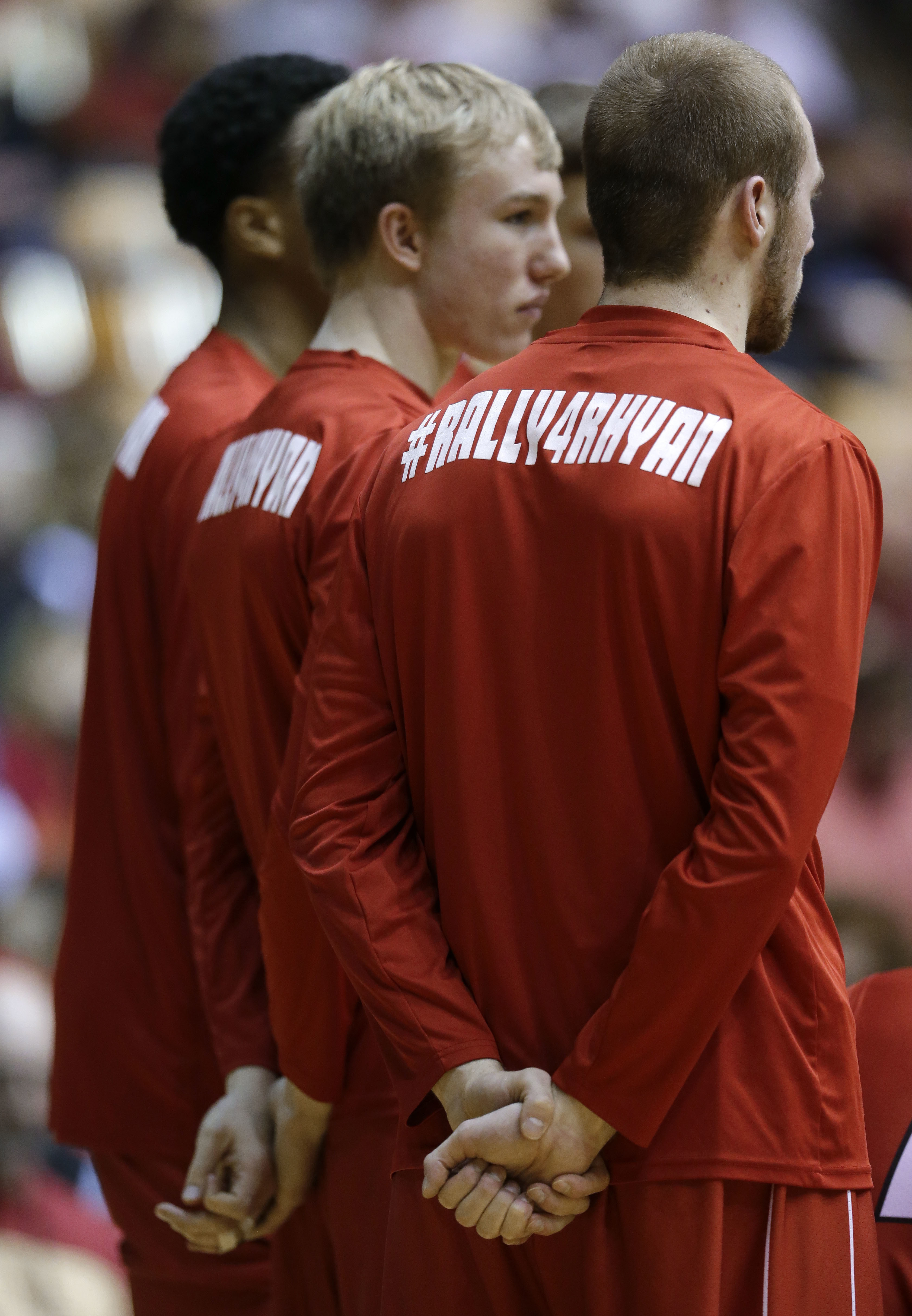 FILE - In this March 5, 2016, file photo, Austin Peay players wear a slogan on their shirts for Rhyan Loos, the 5-year-old granddaughter of coach Dave Loos, during an NCAA college basketball game against UT Martin at the championship of the Ohio Valley Co