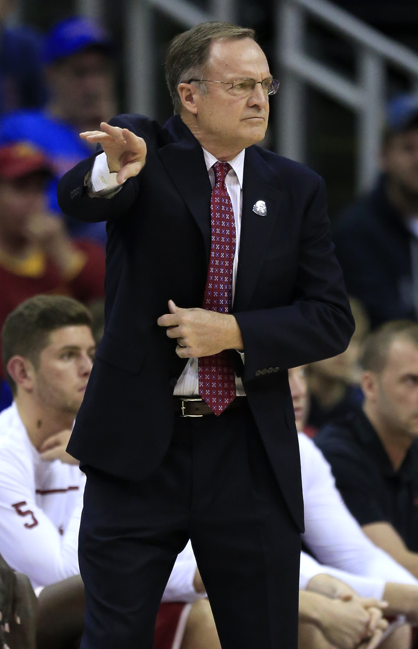 Oklahoma head coach Lon Kruger directs his team during the first half of an NCAA college basketball game against West Virginia in the semifinals of the Big 12 conference tournament in Kansas City, Mo., Friday, March 11, 2016. (AP Photo/Orlin Wagner)