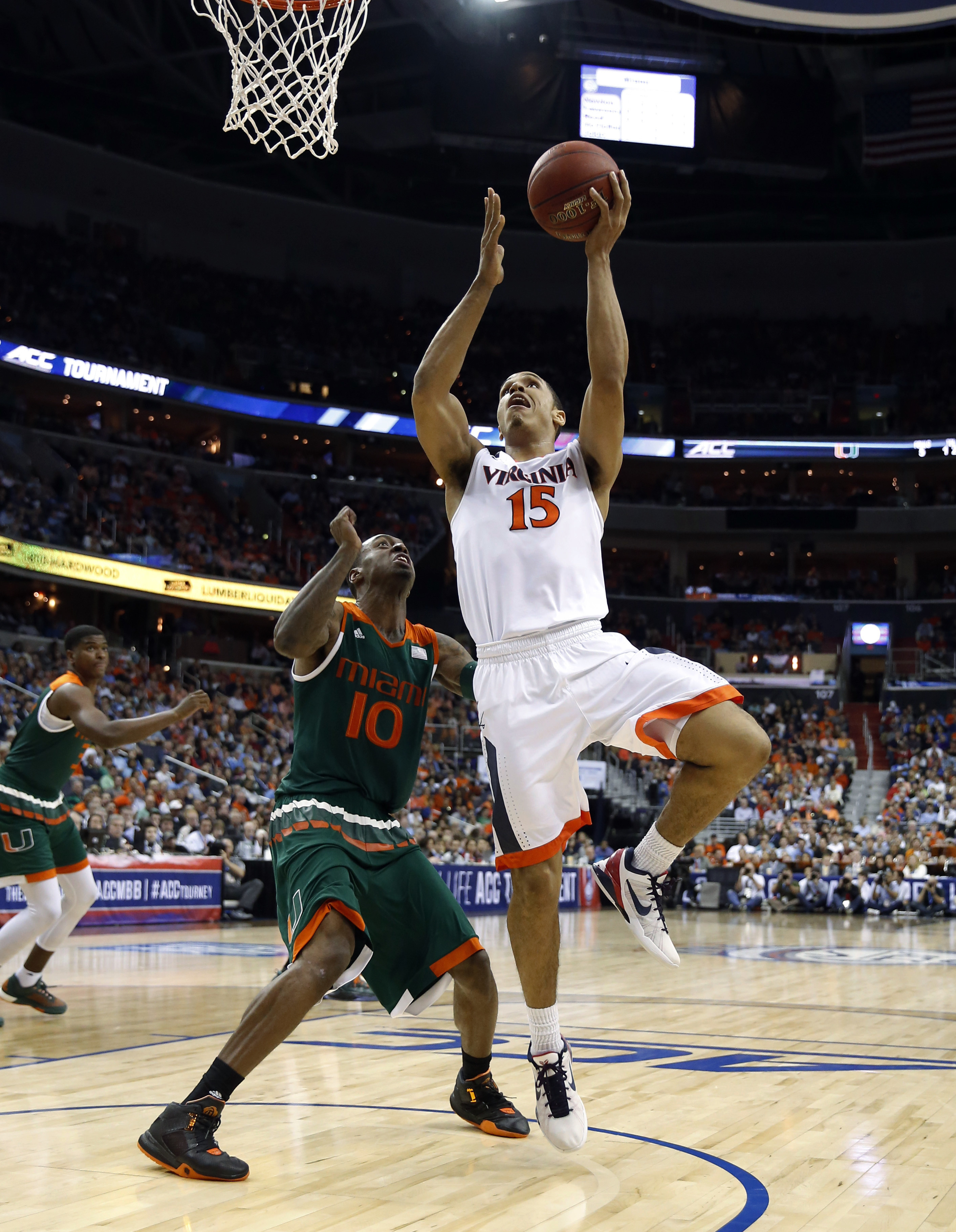 Virginia guard Malcolm Brogdon (15) shoots in front of Miami guard Sheldon McClellan (10) during the first half of an NCAA college basketball game in the Atlantic Coast Conference men's tournament, Friday, March 11, 2016, in Washington. (AP Photo/Alex Bra