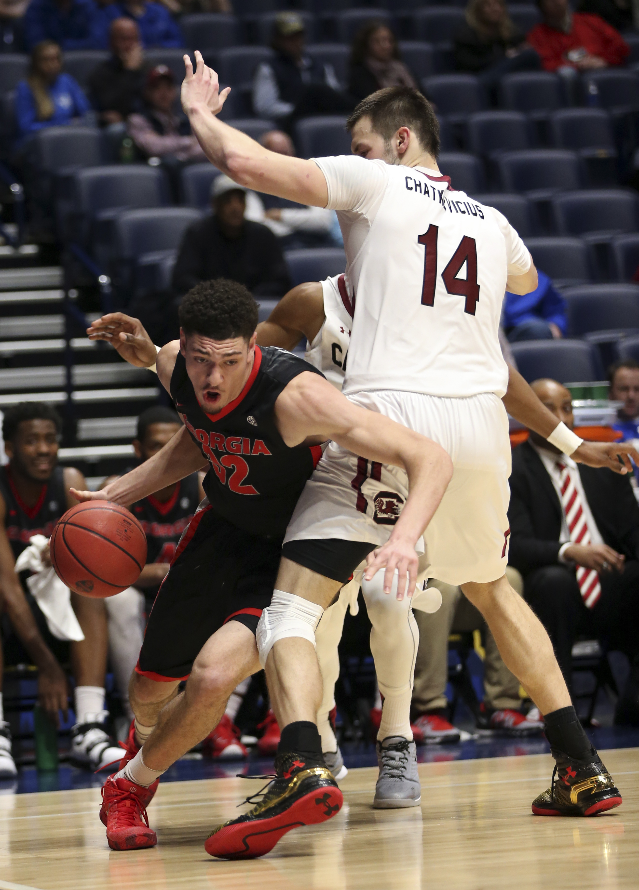 Georgia's Mike Edwards (32) drives around South Carolina's Laimonas Chatkevicius (14) during the second half of an NCAA college basketball game in the Southeastern Conference tournament in Nashville, Tenn., Friday, March 11, 2016. (AP Photo/John Bazemore)