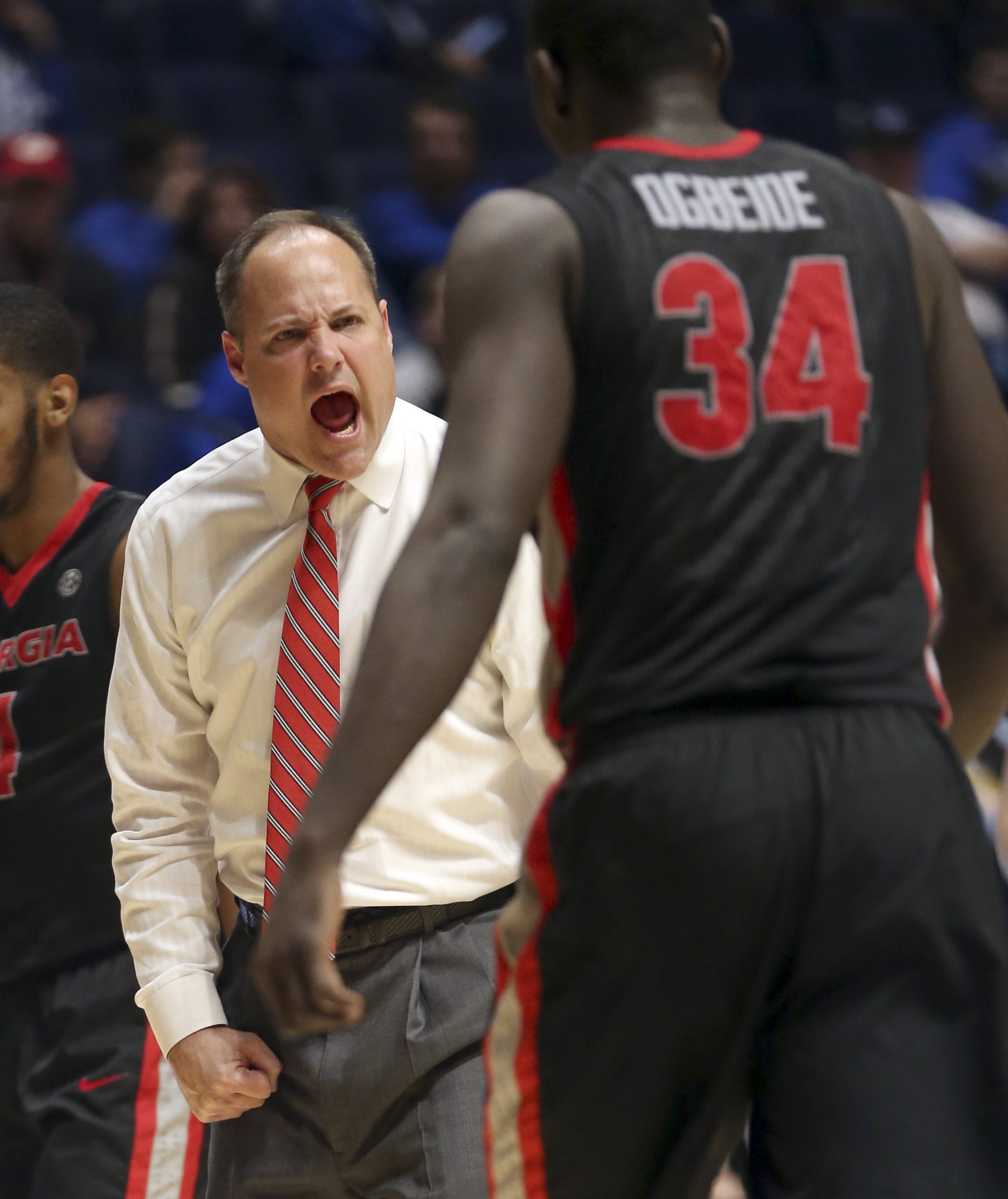 Georgia head coach Mark Fox, left, shouts to Derek Ogbeide, right, during the second half of an NCAA college basketball game against South Carolina in the Southeastern Conference tournament in Nashville, Tenn., Friday, March 11, 2016. (AP Photo/John Bazem