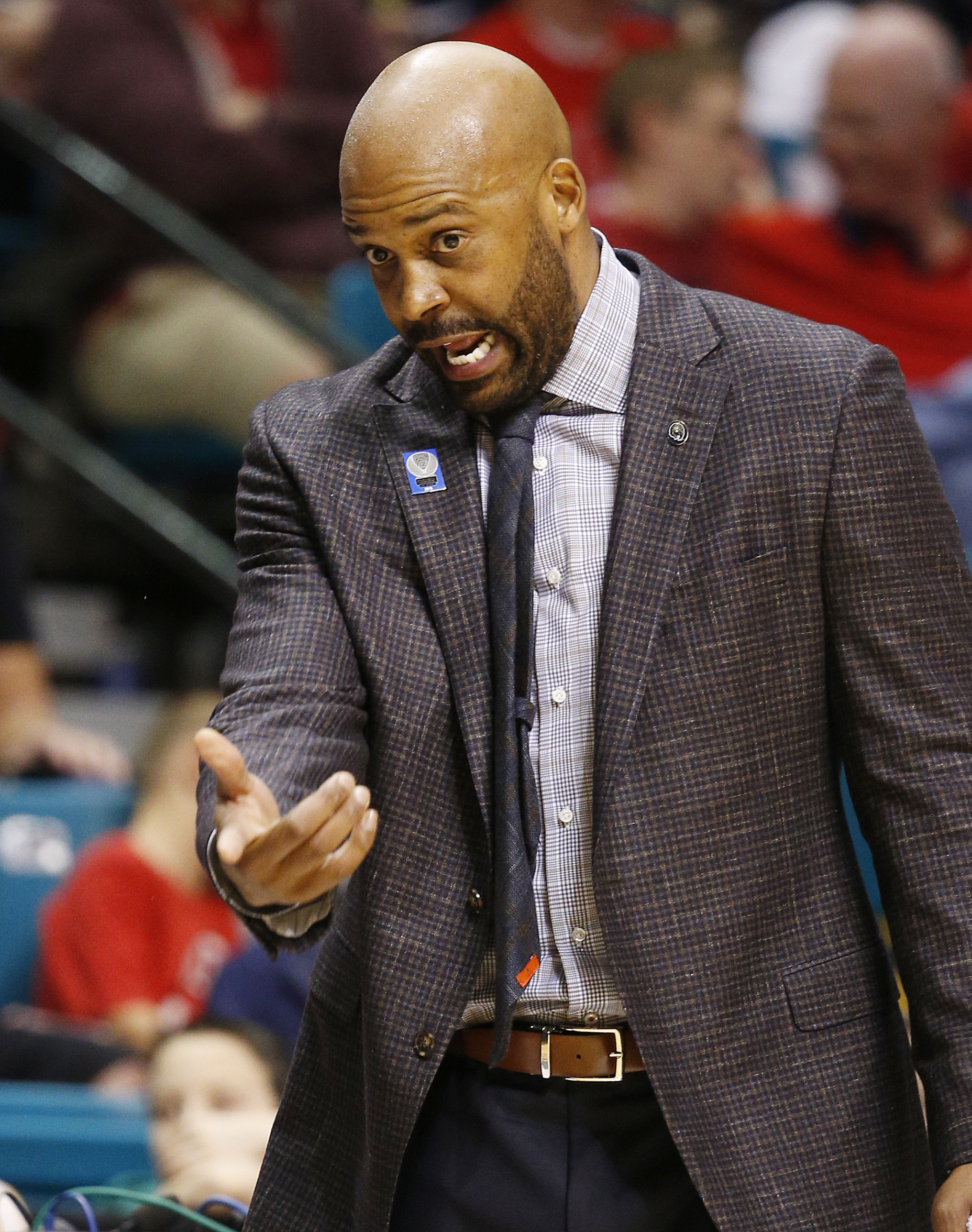 California coach Cuonzo Martin motions to his players during the first half of an NCAA college basketball game against Utah in the semifinals of the Pac-12 men's tournament Friday, March 11, 2016, in Las Vegas. (AP Photo/John Locher)