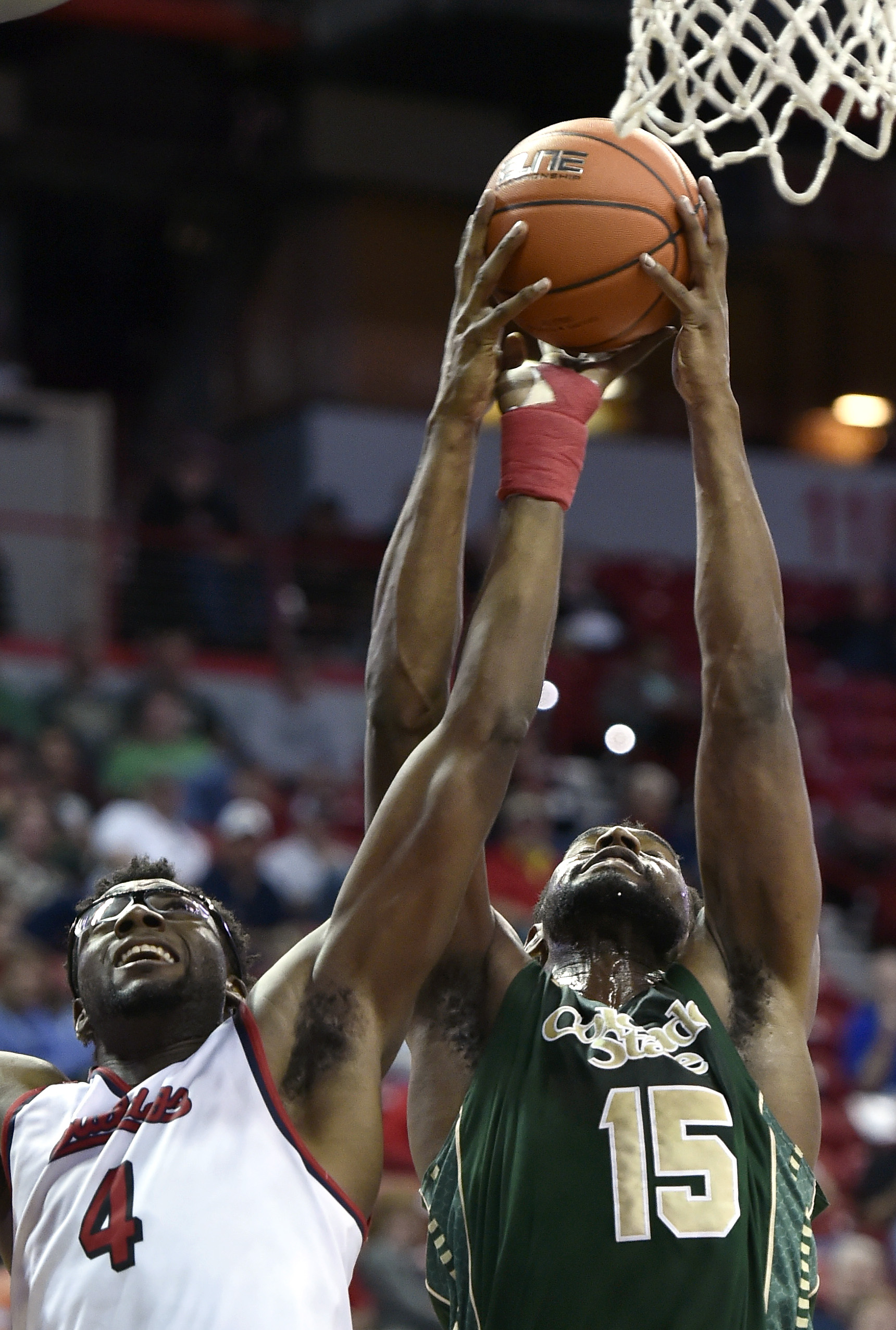 Fresno State's Karachi Edo (4) and Colorado State's Fred Richardson III vie for a rebound during the second half of an NCAA college basketball game in the semifinals at the Mountain West Conference tournament Friday, March 11, 2016, in Las Vegas. Fresno S