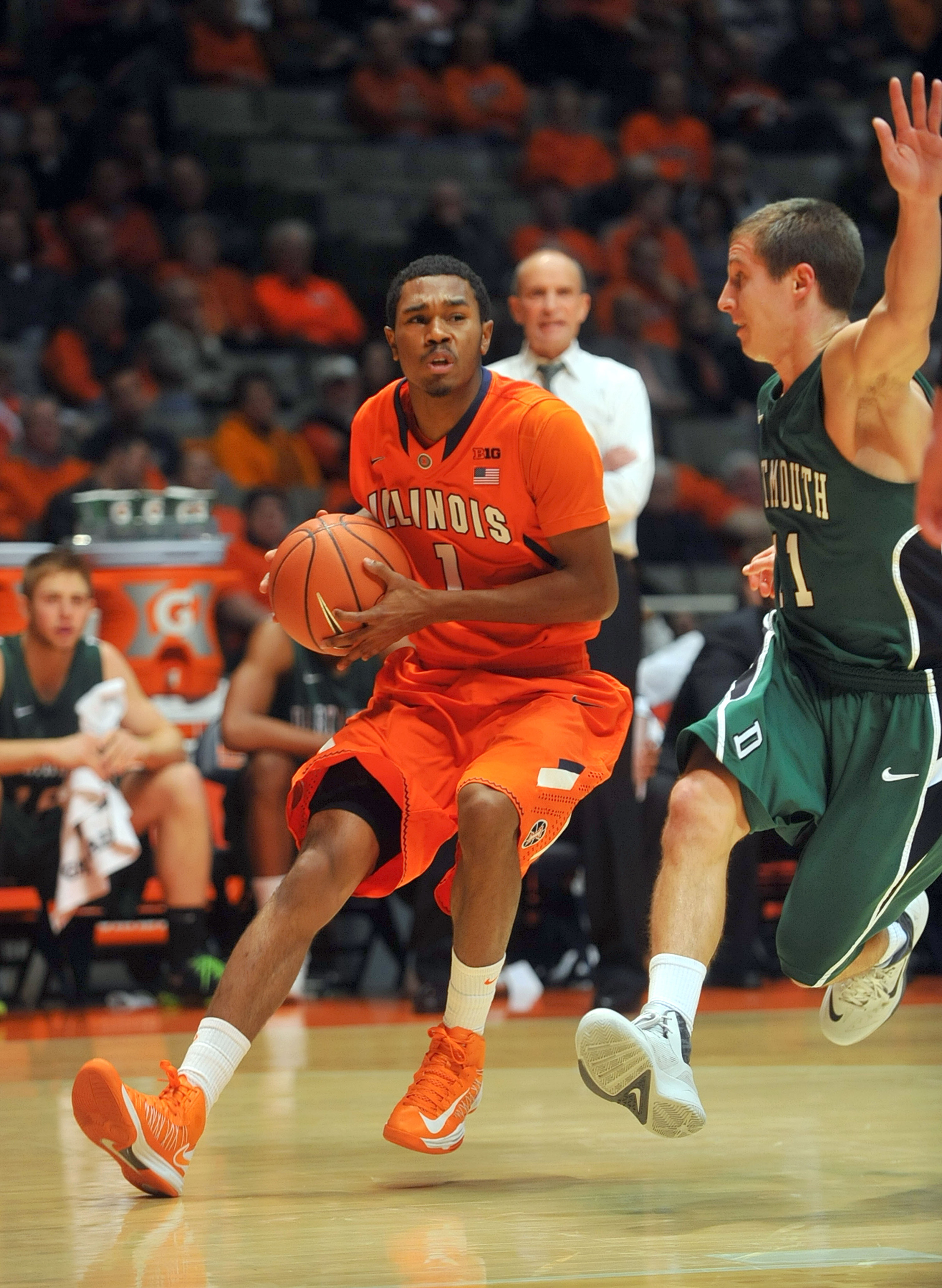 FILE - In this Dec. 10, 2013 file photo, Illinois guard Jaylon Tate (1) drives to drive around Dartmouth guard Alex Mitola (11) in the first half in an NCAA college basketball game in Champaign, Ill. Tate has been arrested on a misdemeanor charge of domes