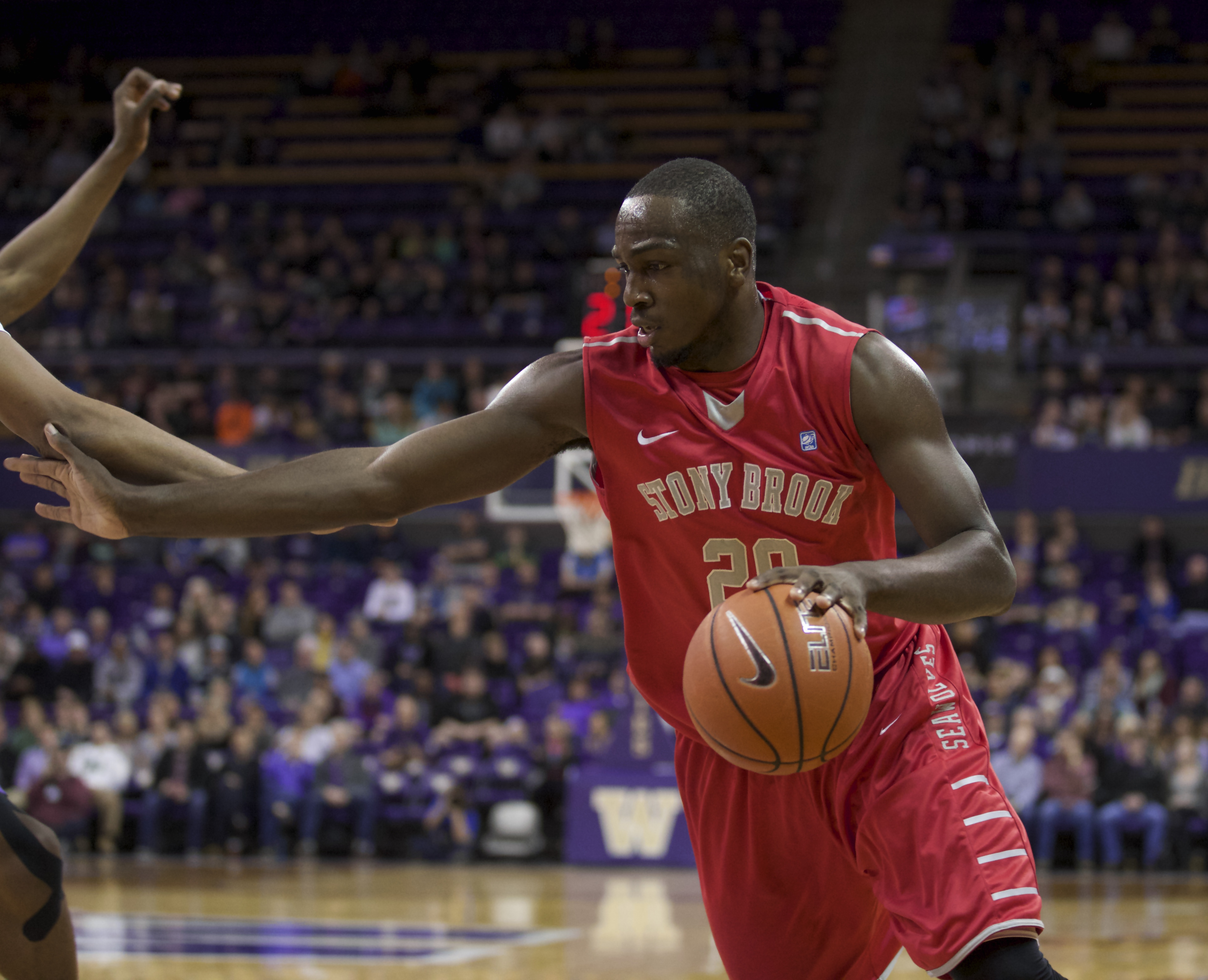 Stony Brook Jameel Warney dribbles the ball during the first half of an NCAA college basketball game against Washington Sunday, Dec. 28, 2014, in Seattle. Stony Brook won 62-57. (AP Photo/Stephen Brashear)