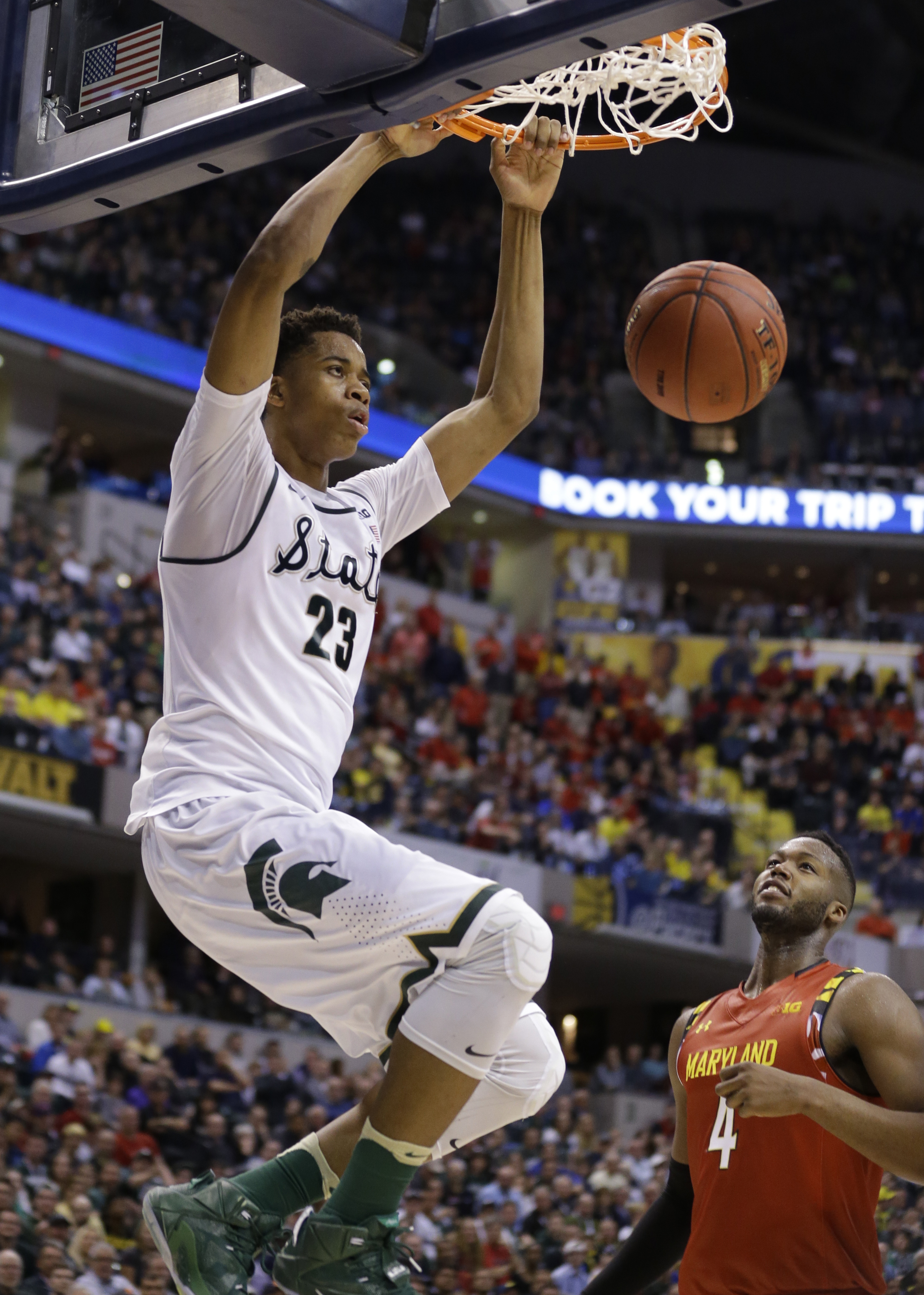 Michigan State's Deyonta Davis (23) dunks as Maryland's Robert Carter (4) watches in the second half of an NCAA college basketball game against Maryland during the semifinals of the Big Ten Conference tournament in Indianapolis, Saturday, March 12, 2016.