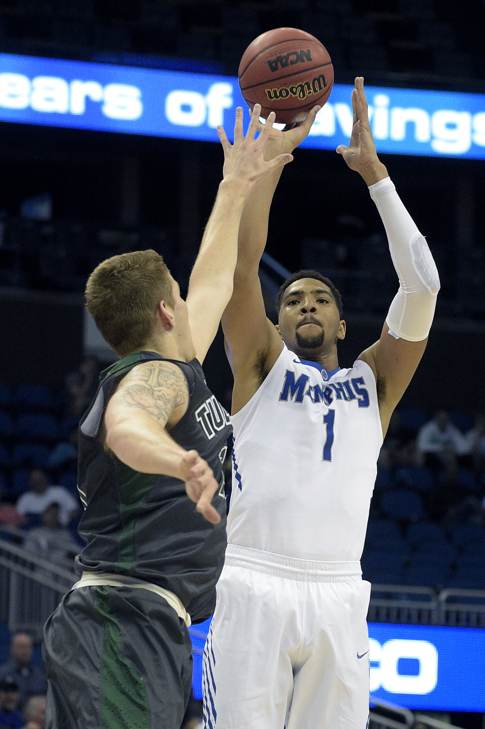 Memphis forward Dedric Lawson (1) goes up for a shot in front of Tulane forward Dylan Osetkowski (21) during the first half of an NCAA college basketball game in the semifinals of the American Athletic Conference men's tournament in Orlando, Fla., Saturda