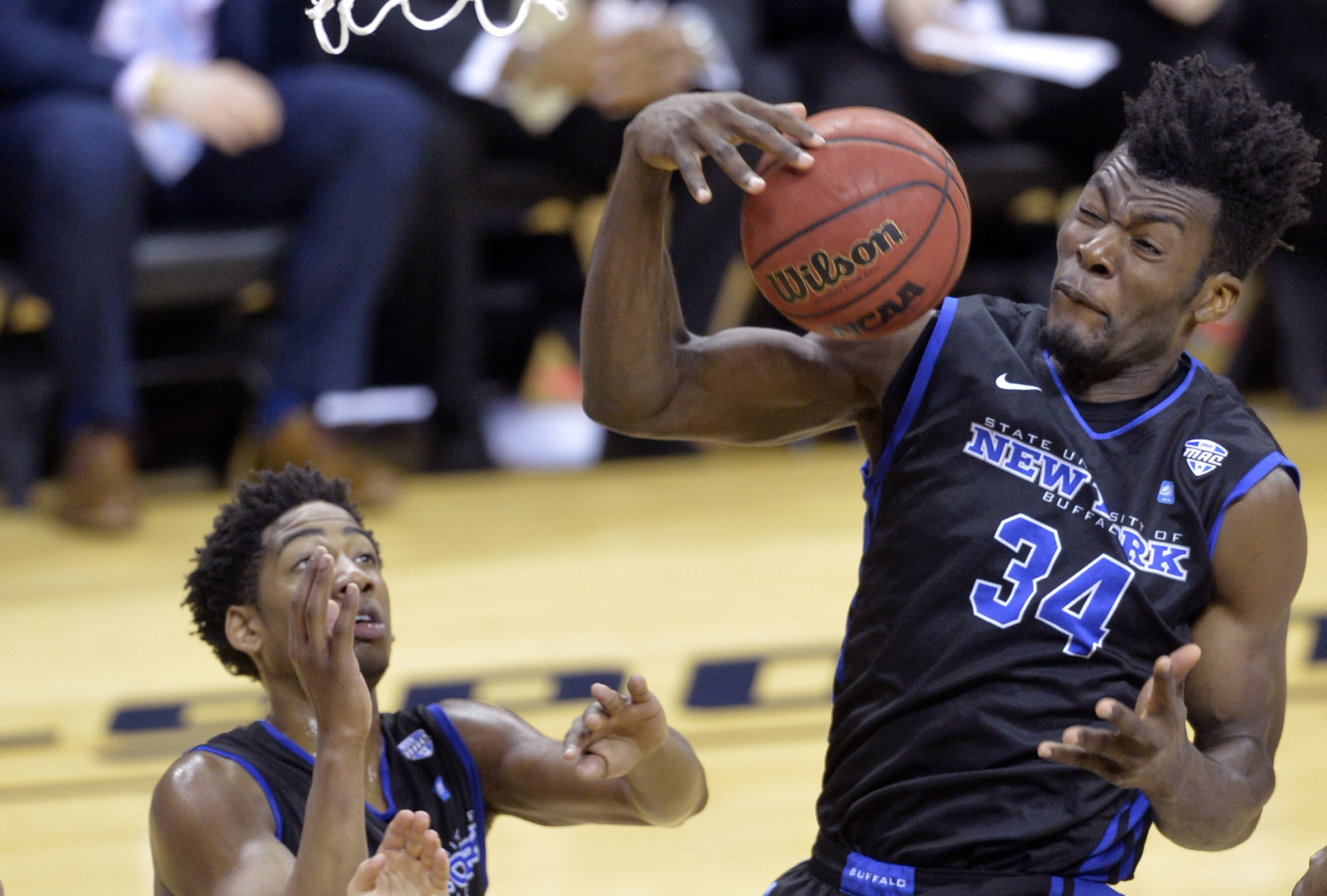 Buffalo's forward Ikenna Smart, right, rebounds beside CJ Massinburg in the first half of an NCAA college basketball game against Akron in the championship of the Mid-American Conference men's tournament, Saturday, March 12, 2016, in Cleveland. (AP Photo/
