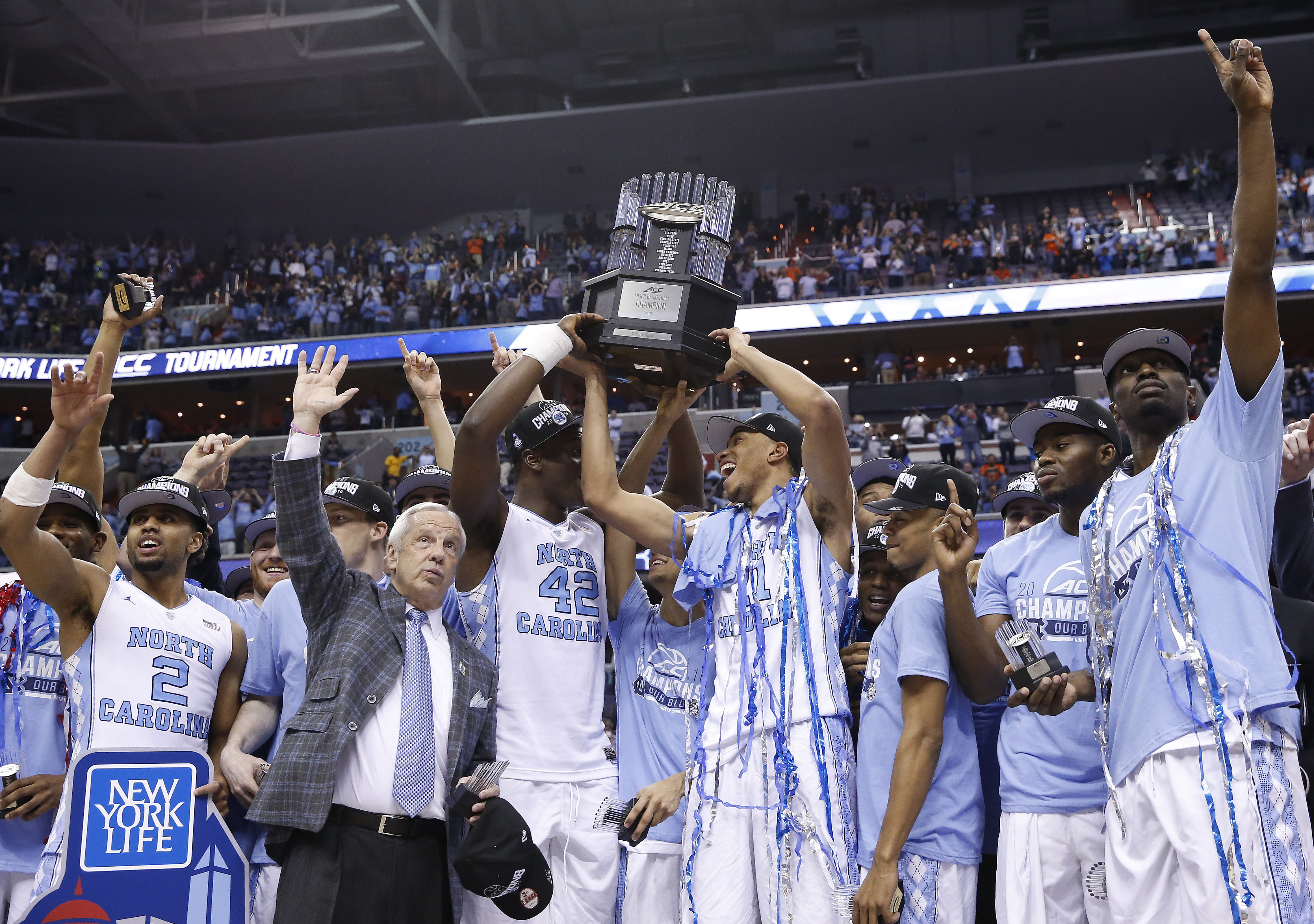 North Carolina head coach Roy Williams and players celebrate after an NCAA college basketball game in the championship of the Atlantic Coast Conference tournament against Virginia, Saturday, March 12, 2016, in Washington. North Carolina won 61-57. (AP Pho