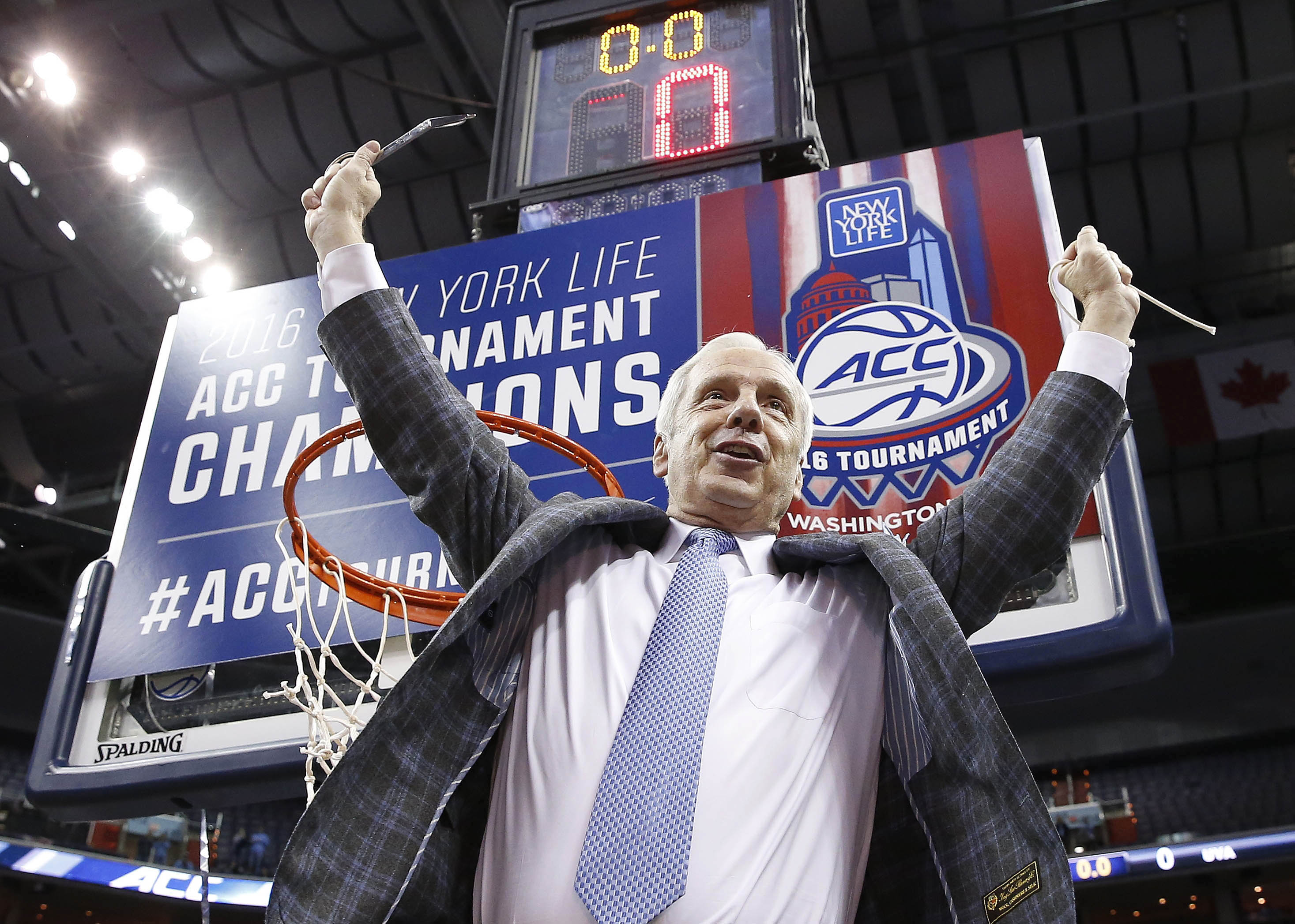 North Carolina head coach Roy Williams holds part of the net after an NCAA college basketball game in the championship of the Atlantic Coast Conference tournament against Virginia, Saturday, March 12, 2016, in Washington. North Carolina won 61-57. (AP Pho