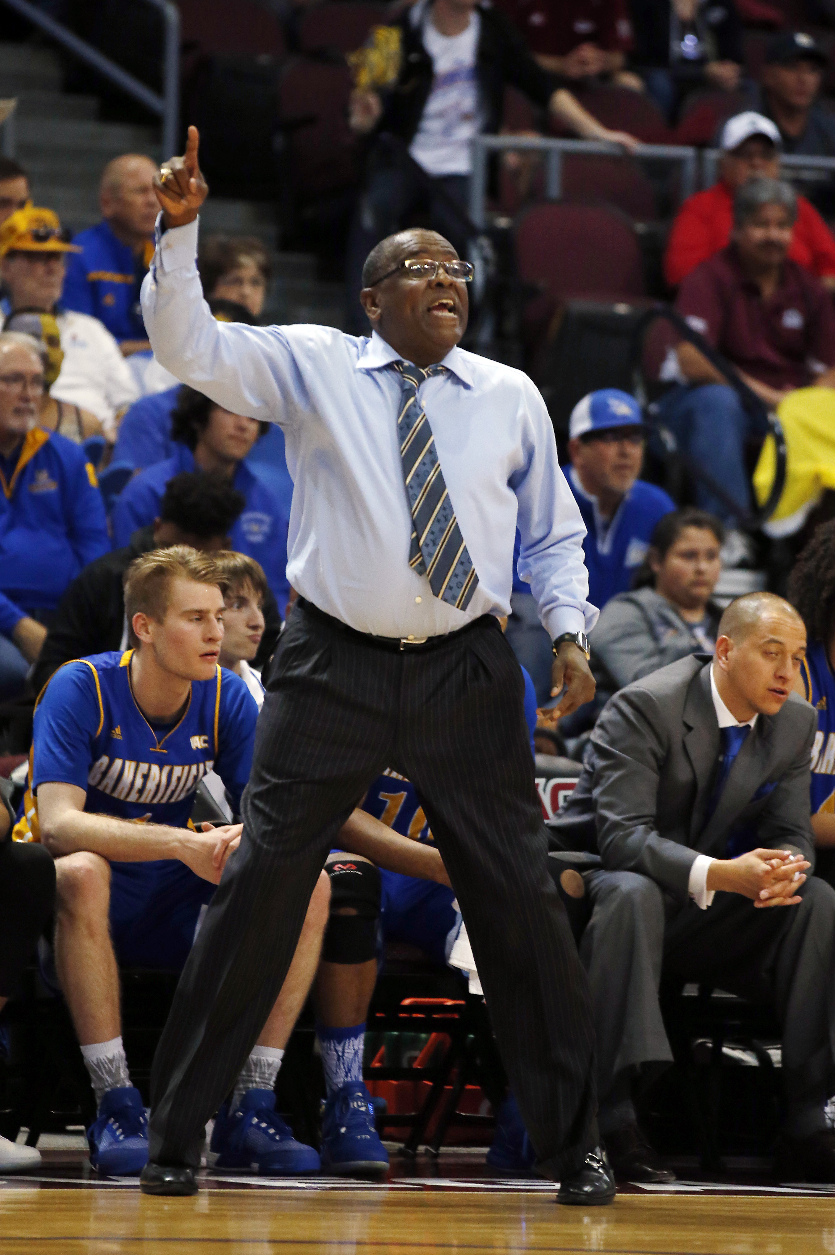 Cal State Bakersfield coach Rod Barnes talks to his team during the first half of an NCAA college basketball game against New Mexico State in the final of the Western Athletic Conference men's tournament Saturday, March 12, 2016, in Las Vegas. (AP Photo/I
