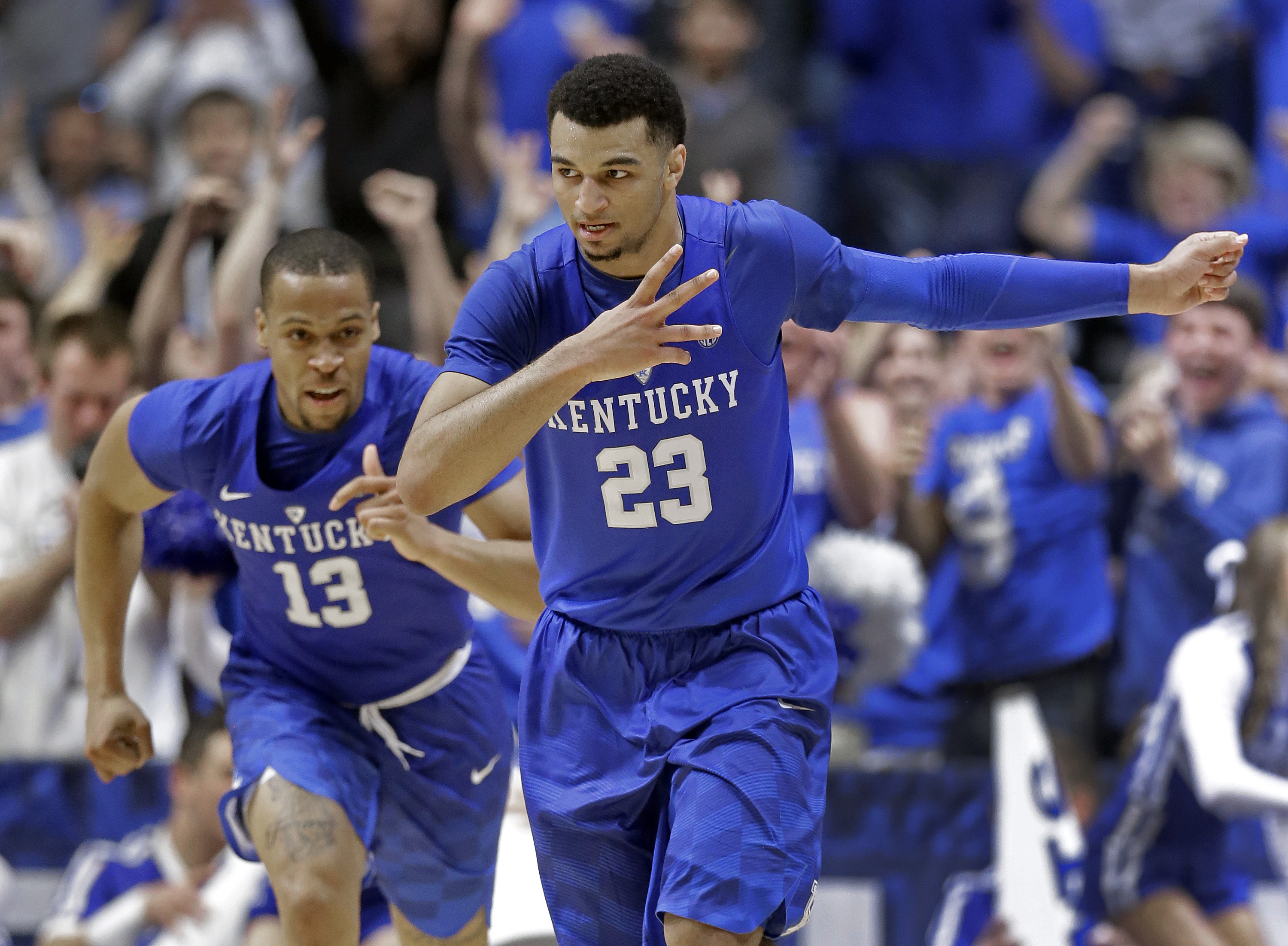 Kentucky's Jamal Murray (23) and Isaiah Briscoe (13) celebrate Murray's three point basket against Texas A&M during the second half of an NCAA college basketball game in the championship of the Southeastern Conference tournament in Nashville, Tenn., Sunda