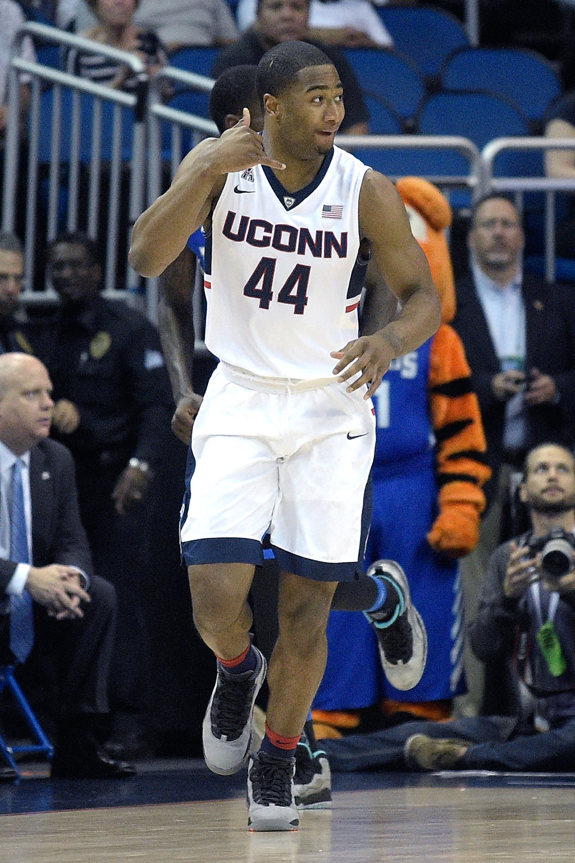 Connecticut guard Rodney Purvis (44) celebrates after scoring a three-pointer during the first half of an NCAA college basketball game against Memphis in the finals of the American Athletic Conference men's tournament in Orlando, Fla., Sunday, March 13, 2