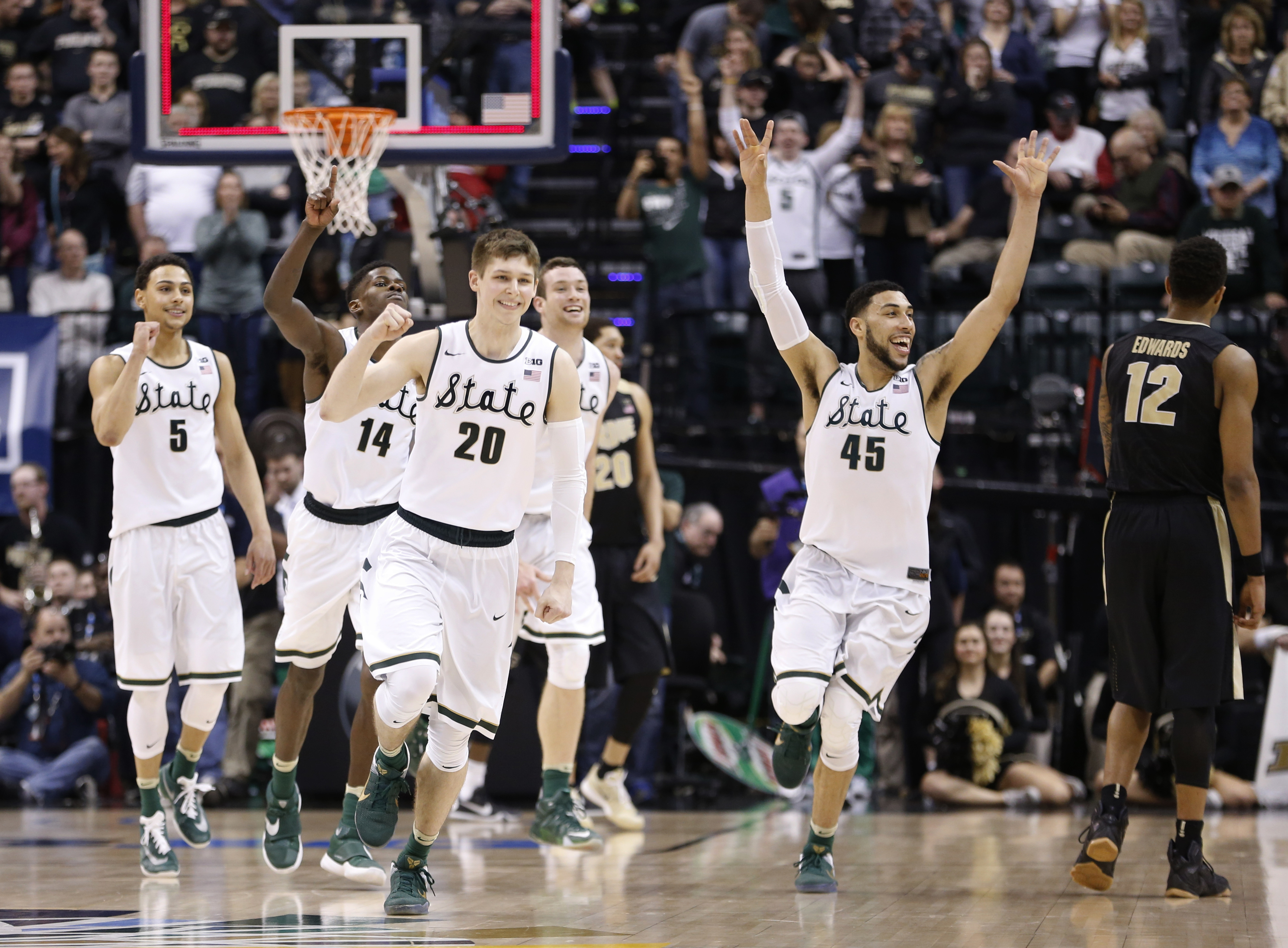 Michigan State players celebrate after an NCAA college basketball game against Purdue in the finals at the Big Ten Conference tournament, Sunday, March 13, 2016, in Indianapolis. Michigan State won 66-62. (AP Photo/AJ Mast)
