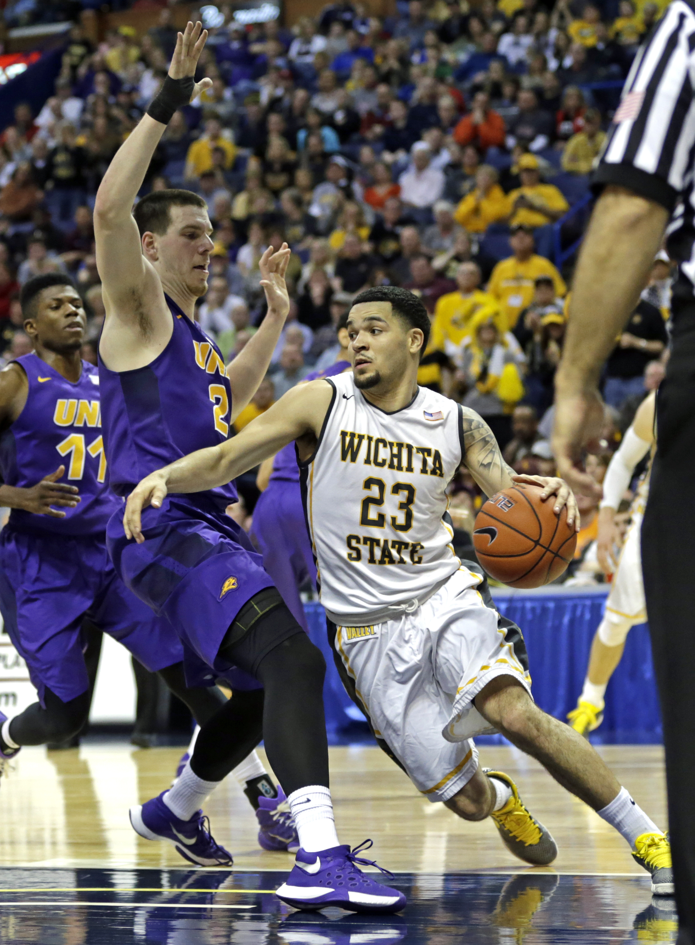 FILE- In this March 5, 2016, file photo, Wichita State's Fred VanVleet (23) drives around Northern Iowa's Klint Carlson (2) during the second half of an NCAA college basketball game in the semifinals of the Missouri Valley Conference men's tournament in S