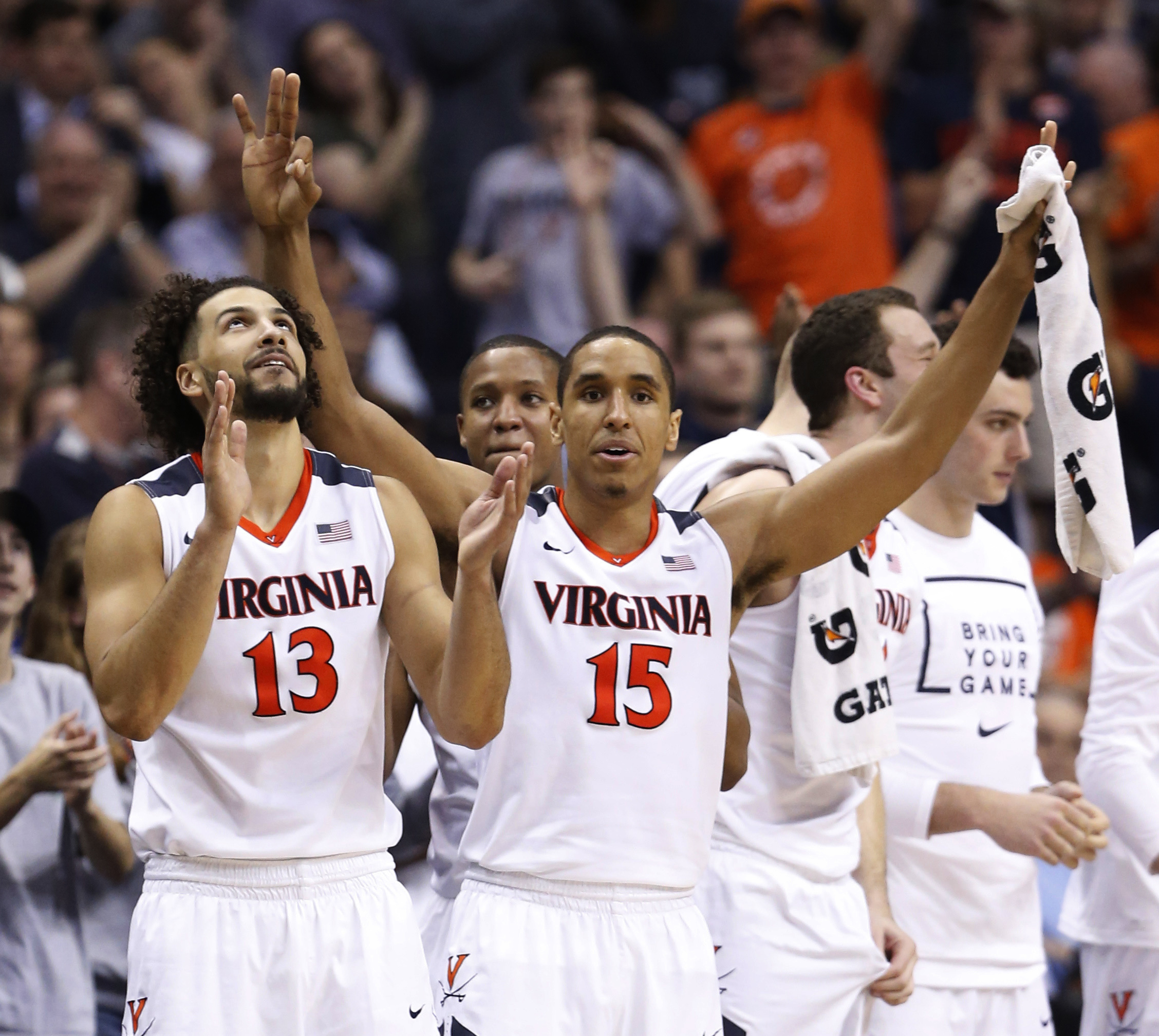 FILE - In this March 10, 2016, file photo, Virginia guard Malcolm Brogdon (15) and forward Anthony Gill (13) cheer their team during the second half against Georgia Tech in an NCAA college basketball game in the Atlantic Coast Conference men's tournament,