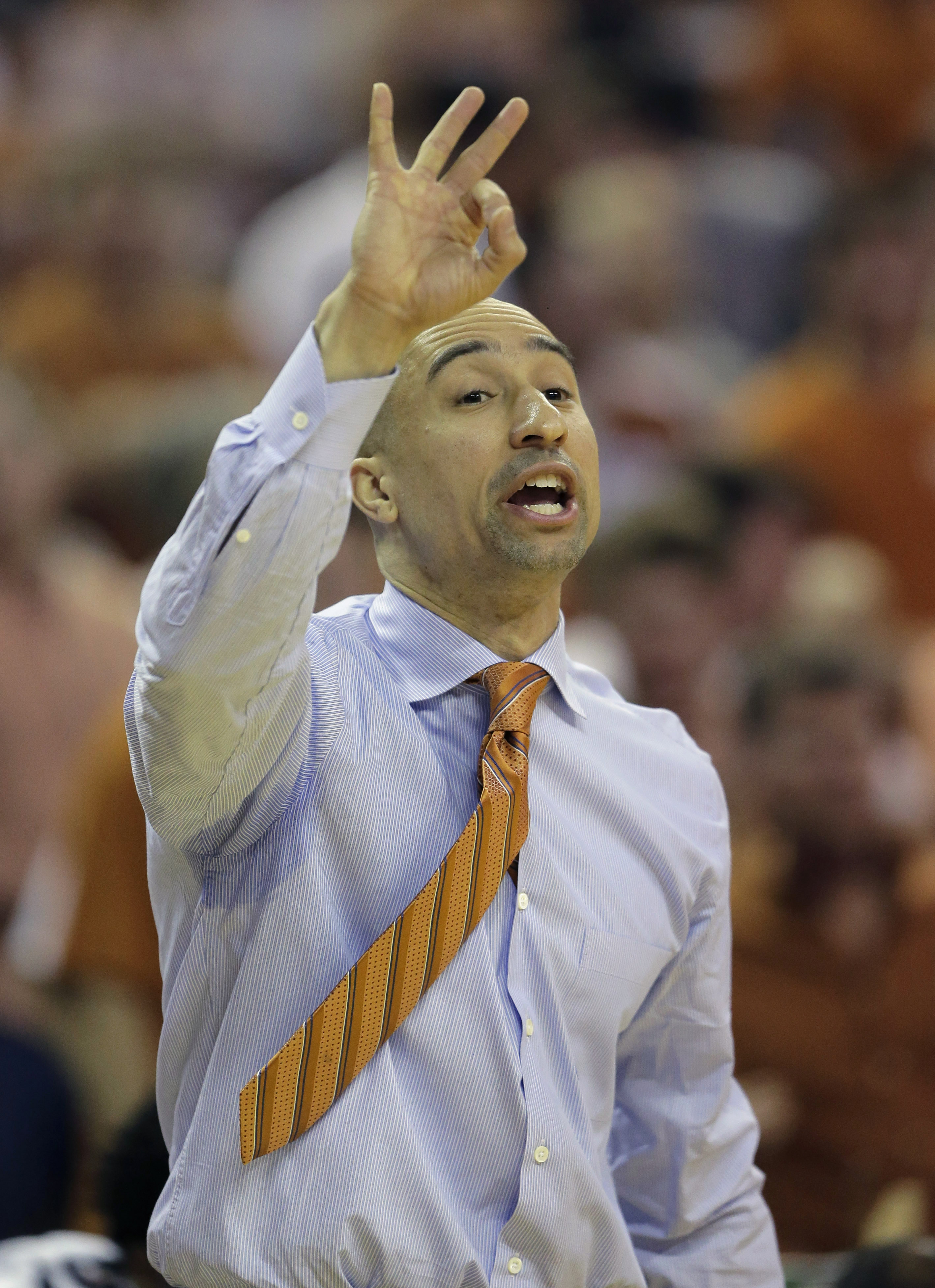 FILE - In this Feb. 27, 2016, file photo, Texas head coach Shaka Smart signals to his players during the first half of an NCAA college basketball game against Oklahoma, in Austin, Texas. Texas hired Shaka Smart away from VCU last April. VCU replaced Smart