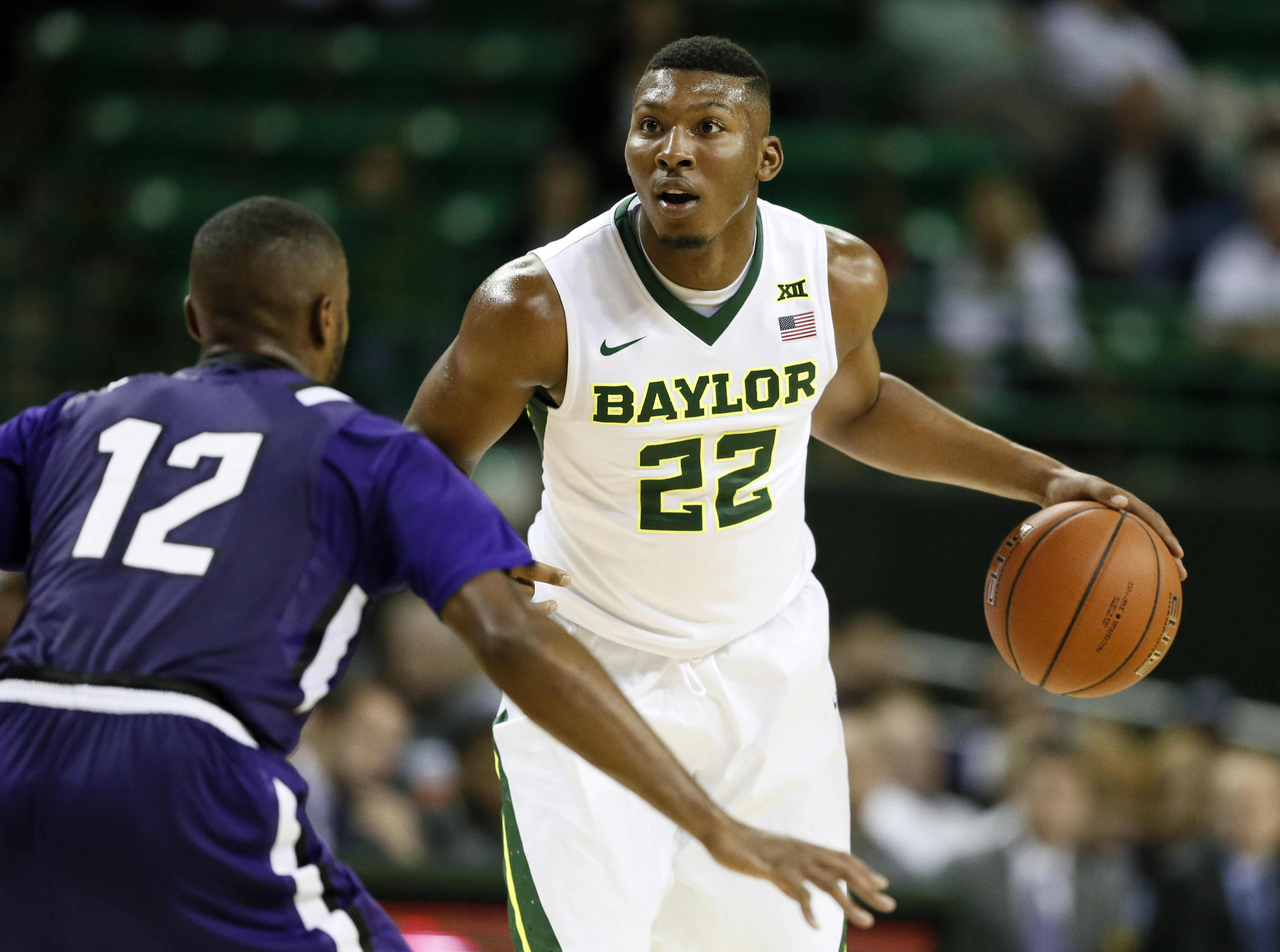 FILE - In this Nov. 13, 2015, file photo, Stephen F. Austin' Dallas Cameron (12) defends as Baylor guard King McClure (22) moves the ball up court in the second half of an NCAA college basketball game, in Waco, Texas. When King McClure was diagnosed with