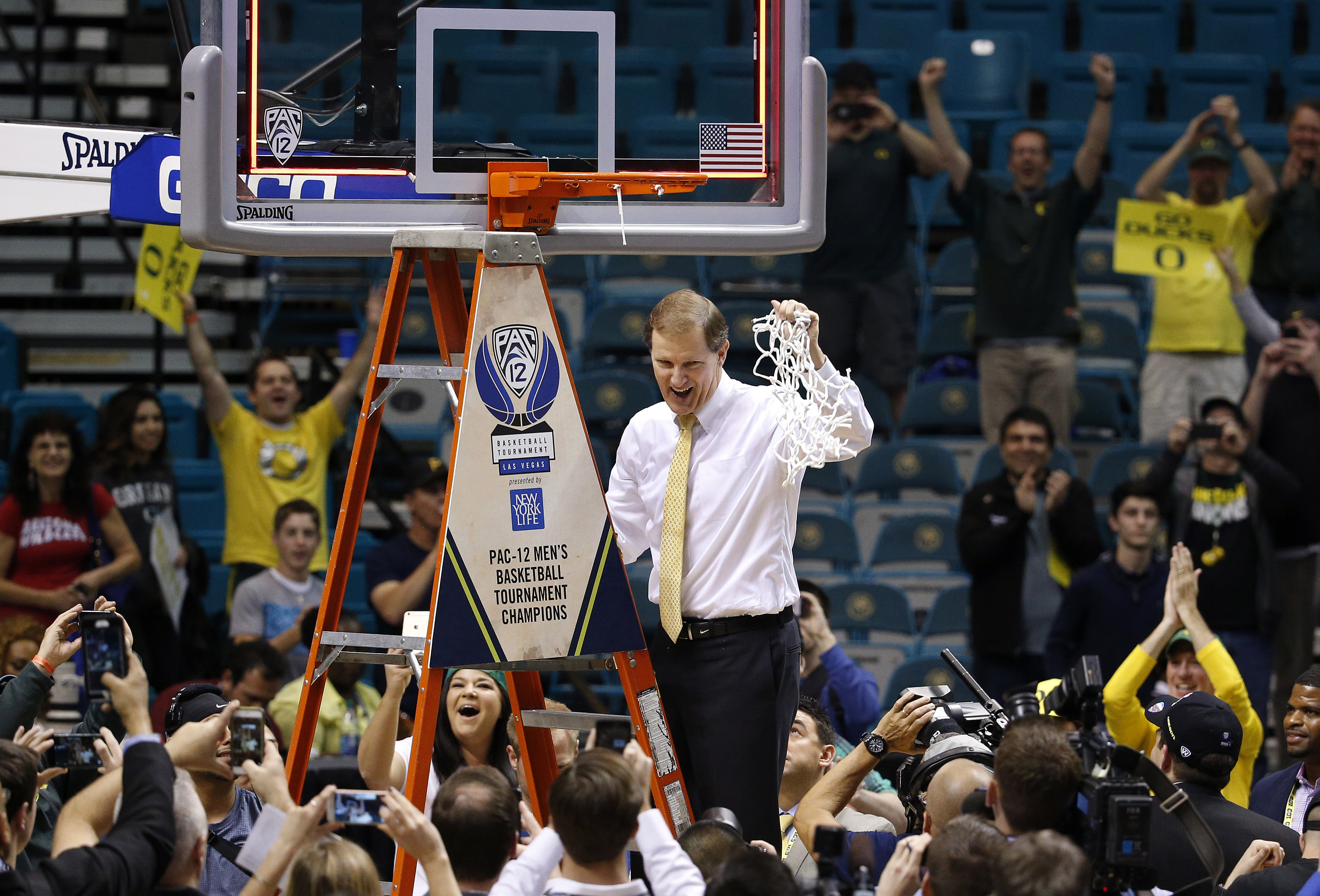 FILE - In tis Saturday, March 12, 2016, file photo, Oregon head coach Dana Altman celebrates while cutting down the net after his team defeated Utah 88-57 in an NCAA college basketball game in the championship of the Pac-12 men's tournament in Las Vegas.