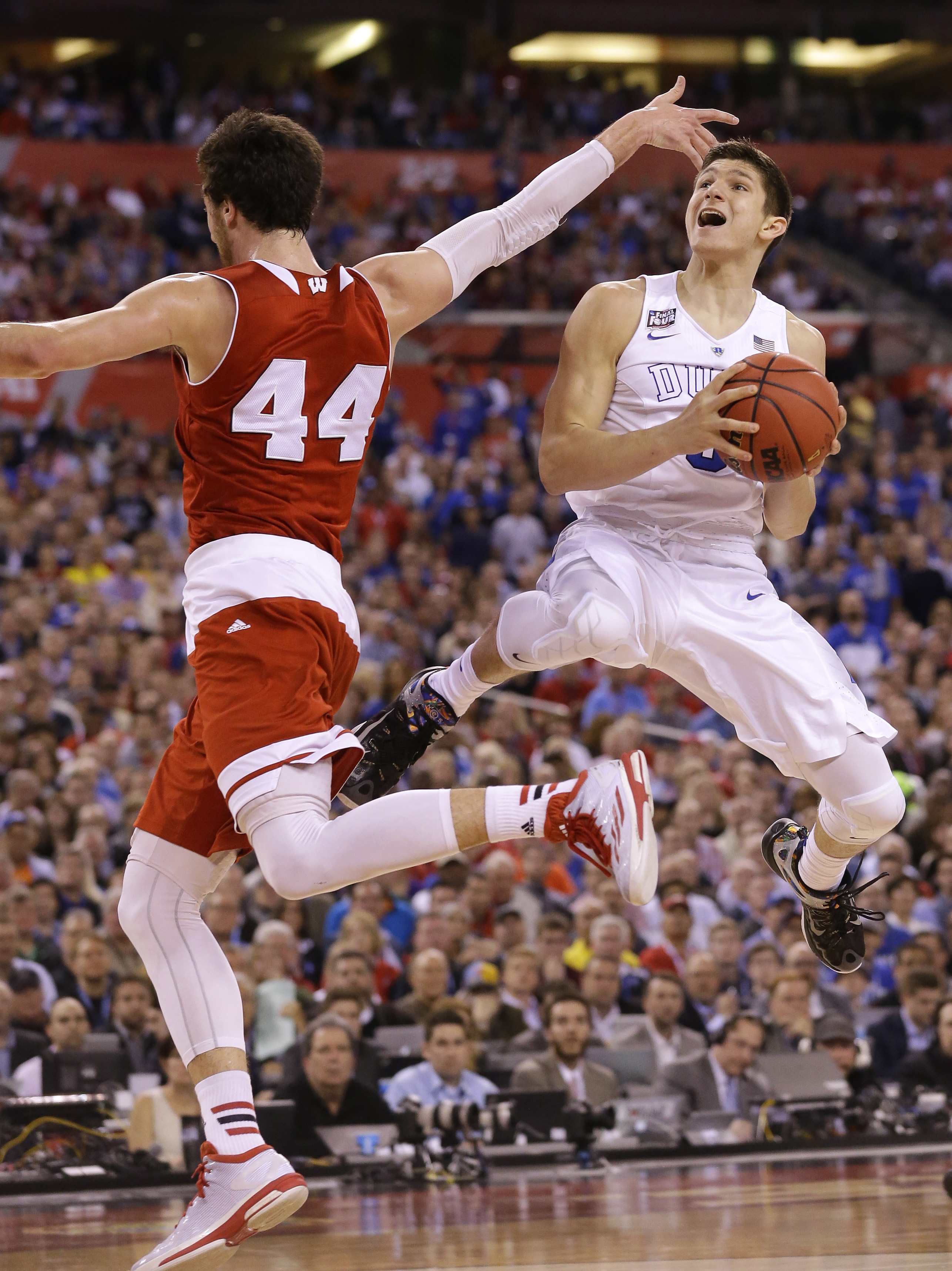 FILE - In this April 6, 2015, file photo, Duke's Grayson Allen drives to the basket as Wisconsin's Frank Kaminsky defends during the championship game of the NCAA college basketball men's tournament in Indianapolis. Coach Mike Krzyzewski went with a hunch