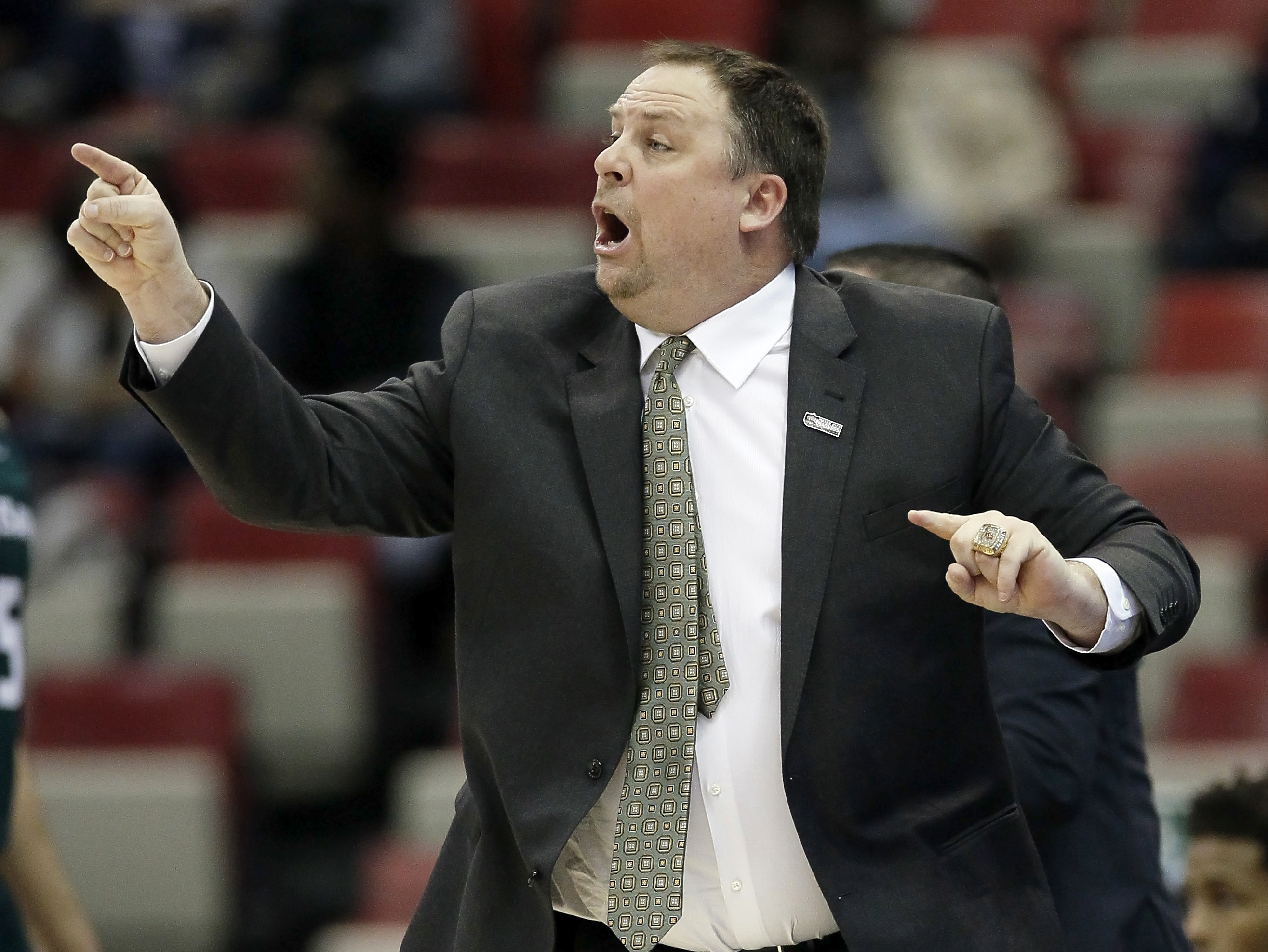 FILE - In this March 7, 2016, file photo, Green Bay coach Linc Darner shouts instructions to his team during an NCAA college basketball game against Valparaiso in the Horizon League men's tournament in Detroit. The Phoenix score 84.2 points per game in Da