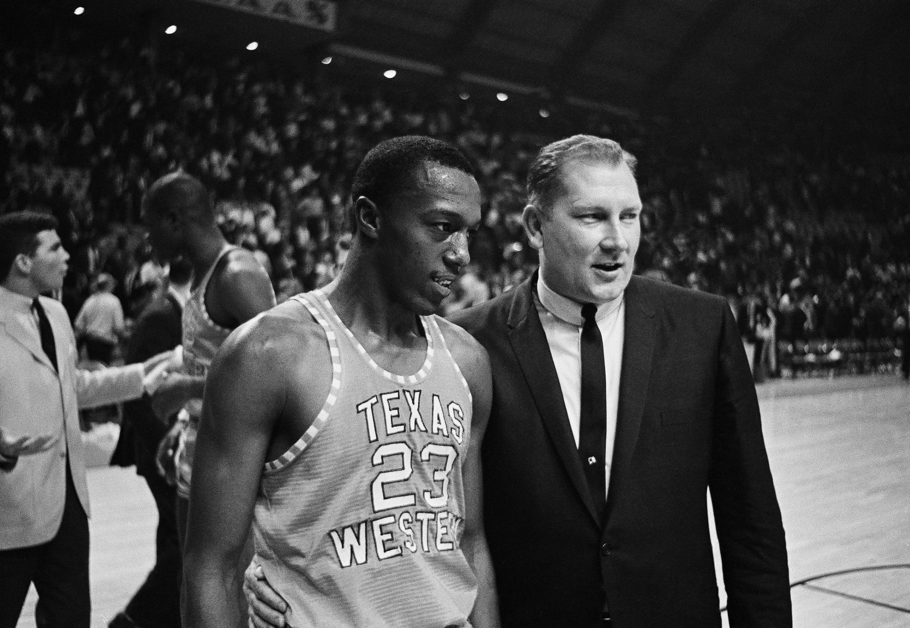 FILE - In this March 18, 1966, file photo, Texas Western coach Don Haskins, right, escorts Orsten Artis off the court after Texas Western defeated Utah in a semifinal in the NCAA men's college basketball tournament, at the University of Maryland, in Colle