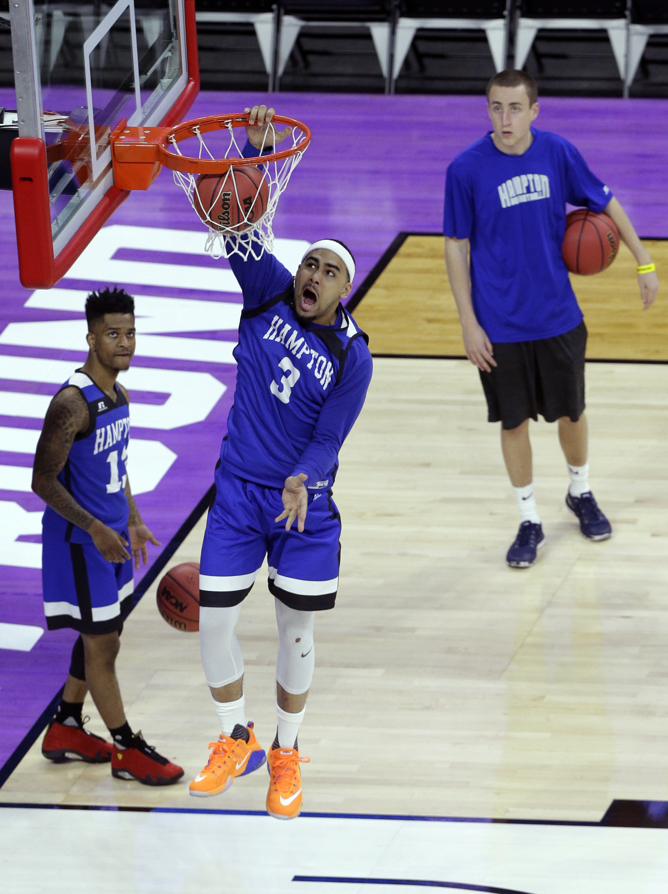 Hampton's Quinton Chievous dunks during practice for a first-round men's college basketball game in the NCAA Tournament in Raleigh, N.C., Wednesday, March 16, 2016. Hampton plays Virginia on Thursday. (AP Photo/Chuck Burton)