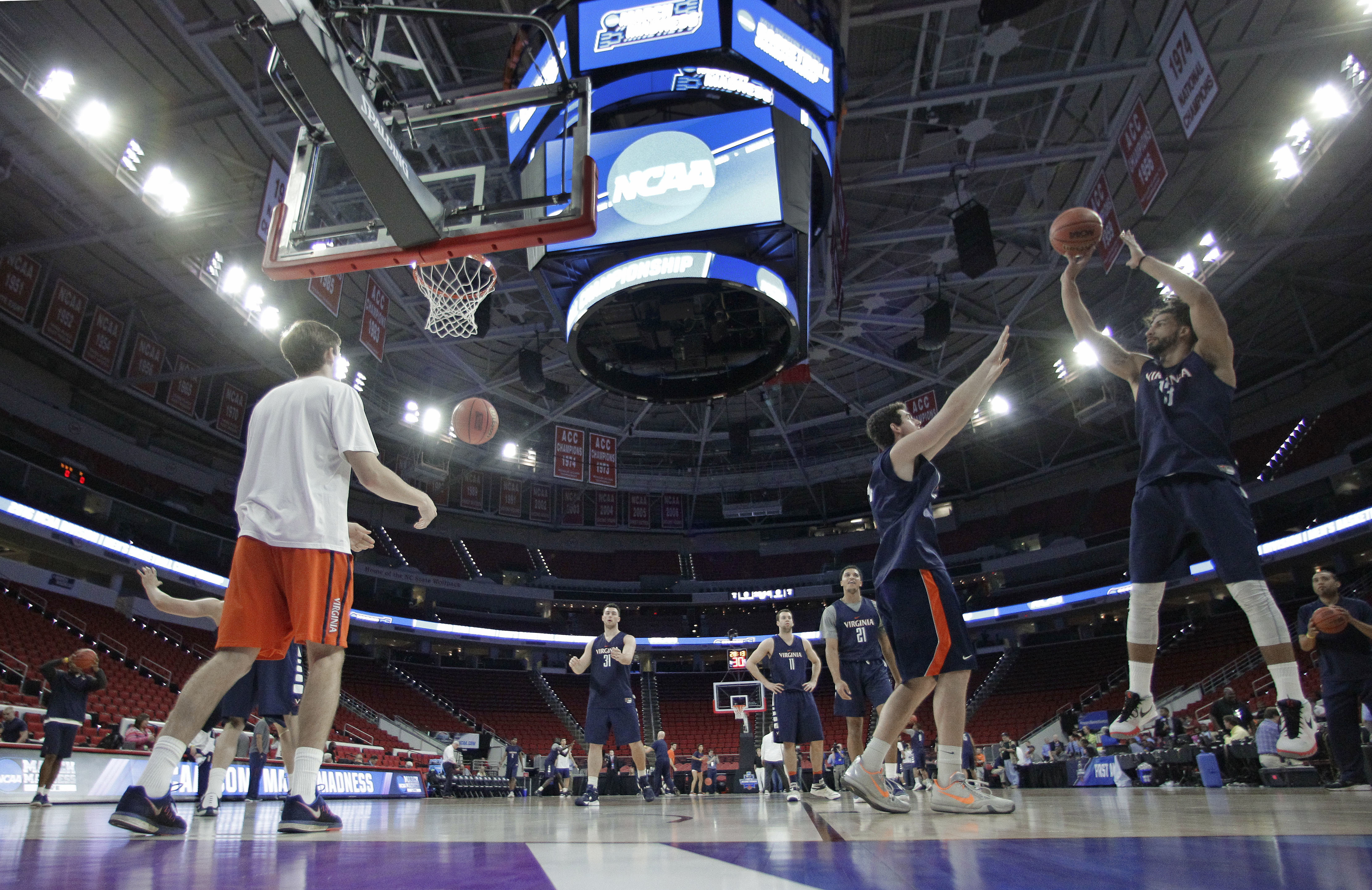 Virginia's Anthony Gill, right, shoots over a teammate during practice for a first-round men's college basketball game in the NCAA Tournament in Raleigh, N.C., Wednesday, March 16, 2016. Virginia plays Hampton on Thursday. (AP Photo/Chuck Burton)