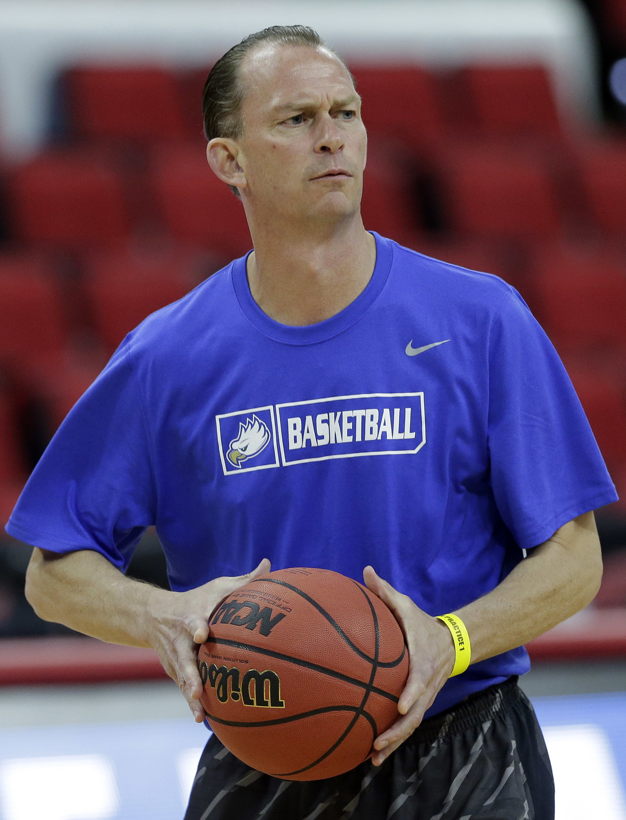 Florida Gulf Coast coach Joe Dooley works with his team during practice for an NCAA college basketball men's tournament first-round game in Raleigh, N.C., Wednesday, March 16, 2016. Florida Gulf Coast plays North Carolina on Thursday. (AP Photo/Gerry Broo