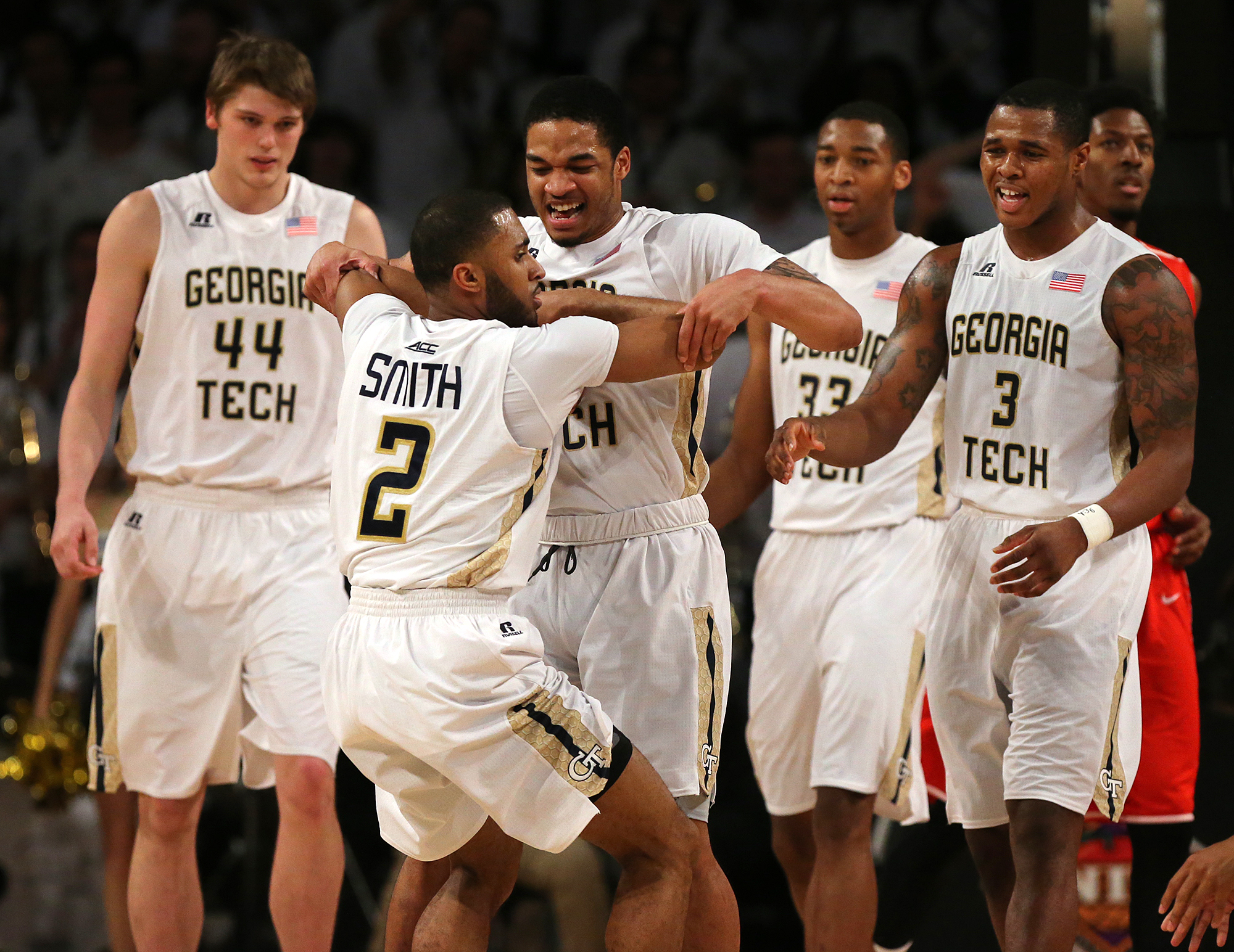 Georgia Tech guard Adam Smith is pulled up from the floor by Tadric Jackson after he hit a 2-pointer and was fouled during an NCAA college basketball game against Houston in the first round of the NIT on Wednesday, March 16, 2016, in Atlanta. (Curtis Comp