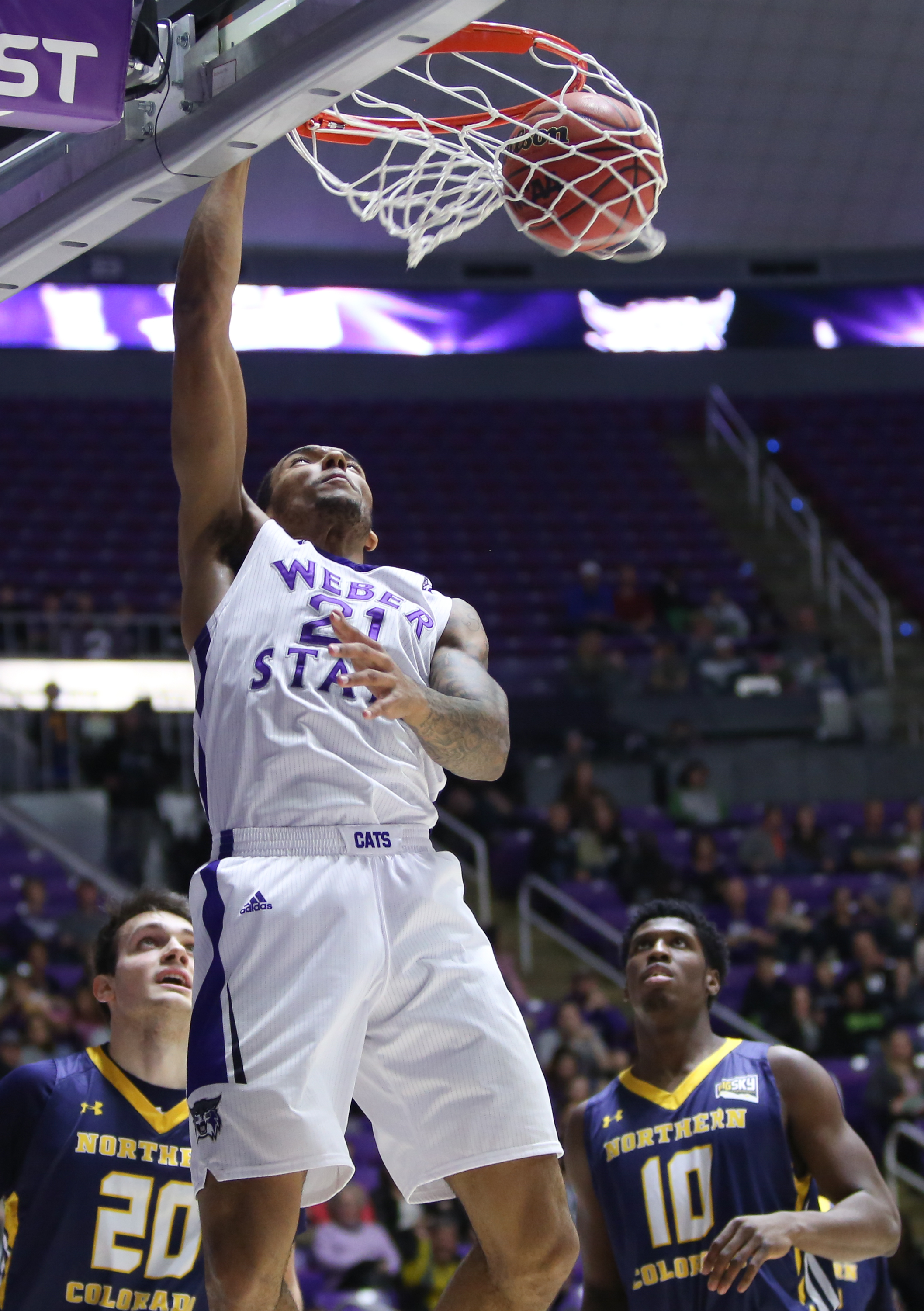 FILE  - In this Jan. 9, 2016, file photo, Weber State's Joel Bolomboy dunks against Northern Colorado during an NCAA college basketball game, in Ogden, Utah. The 6-foot-9 senior is one of five finalists for the Kareem Abdul-Jabbar Award given annually to
