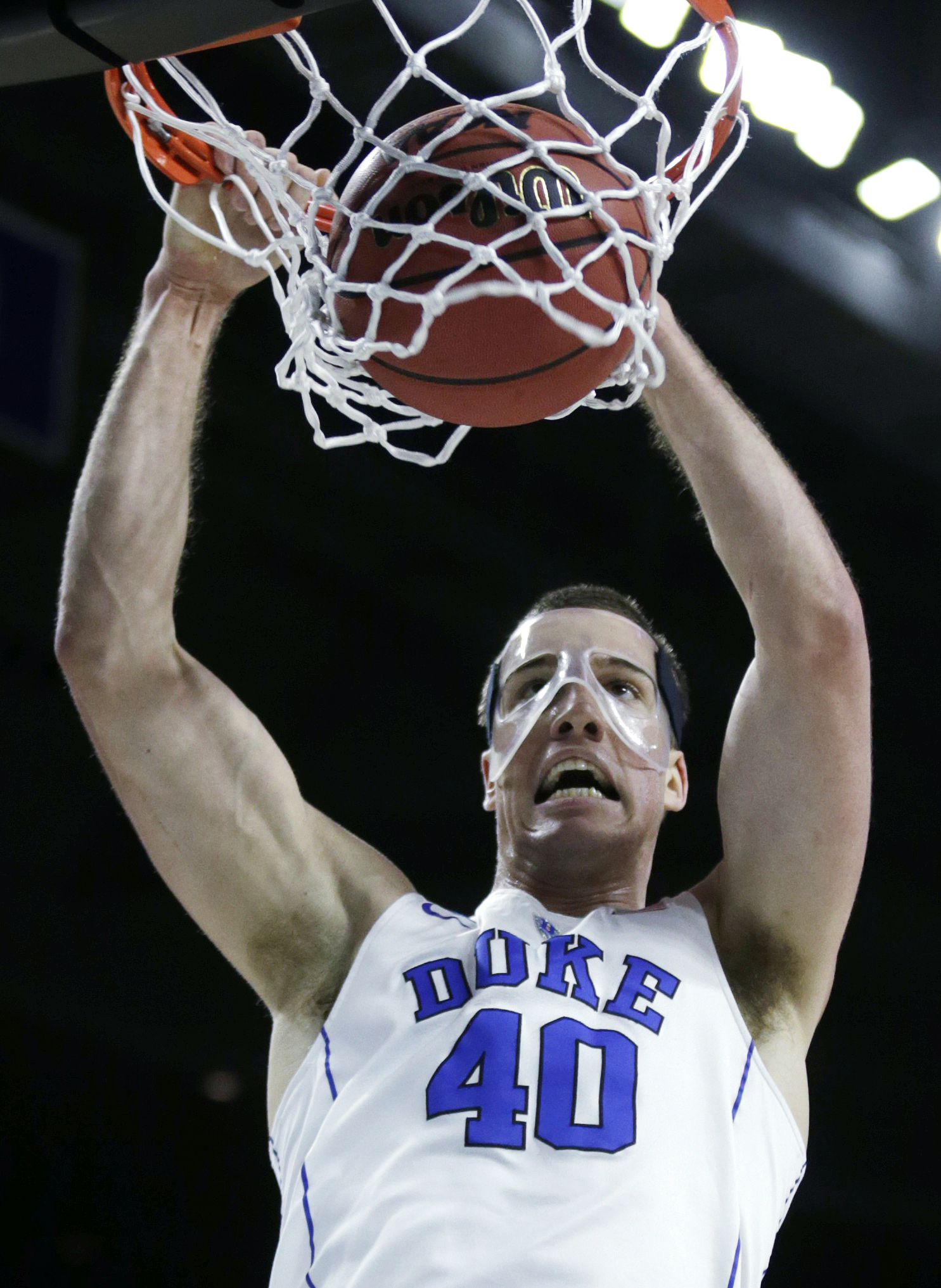 Duke center Marshall Plumlee (40) slams a dunk against North Carolina-Wilmington in the first half during the first round of the NCAA college men's basketball tournament in Providence, R.I., Thursday, March 17, 2016. (AP Photo/Charles Krupa)